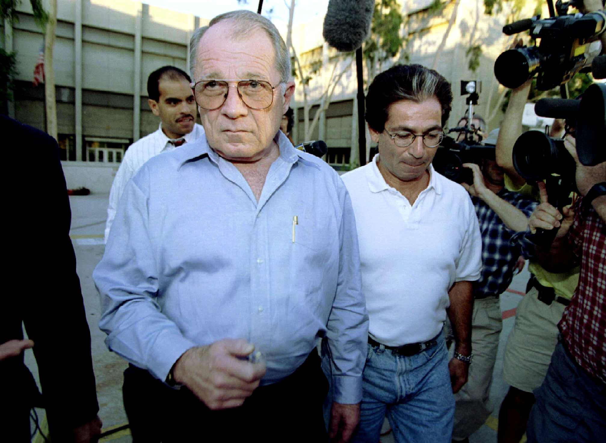 Defense attorneys F. Lee Bailey (l) and Robert Kardashian leave the Los Angeles Mens Central Jail after visiting their client, double murder defendant OJ Simpson, October 2, 1995. REUTERS/Jeff Vinnick/File Photo