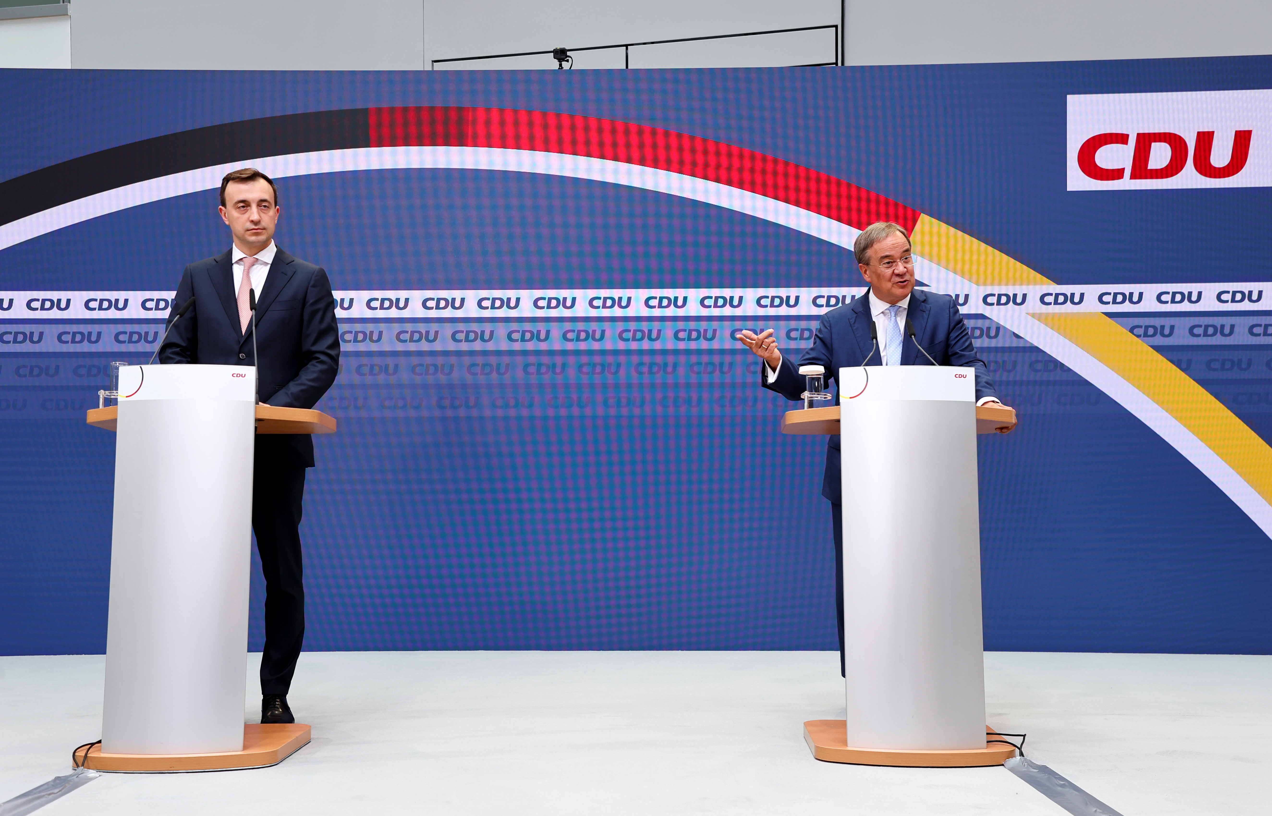 Christian Democratic Union (CDU) leader and top candidate for chancellor Armin Laschet and secretary general Paul Ziemiak hold a news conference, one day after the German general elections, in Berlin, Germany, September 27, 2021. REUTERS/Fabrizio Bensch