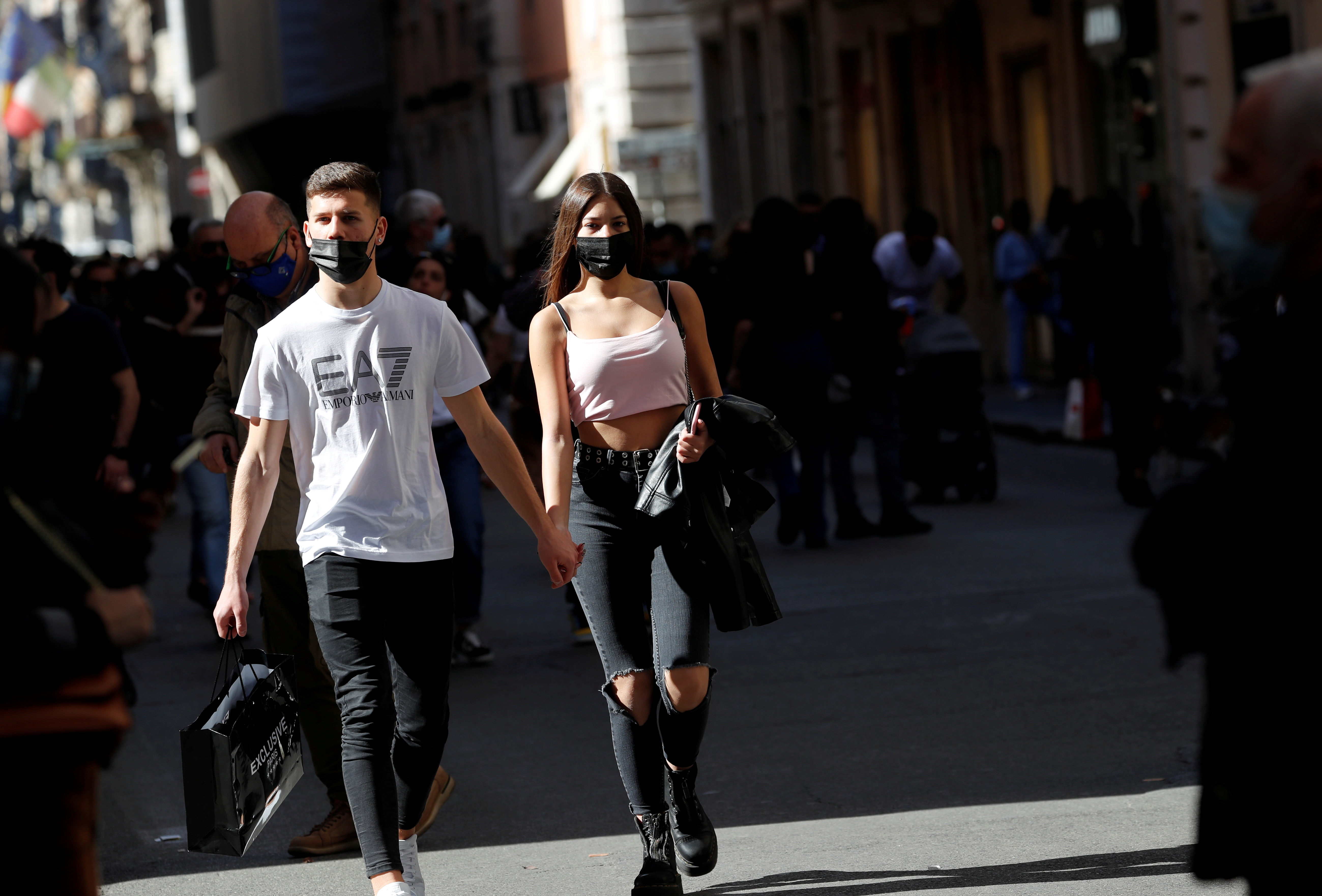 People walk down Via del Corso street amid the coronavirus disease (COVID-19) pandemic in Rome, Italy, April 24, 2021. REUTERS/Remo Casilli