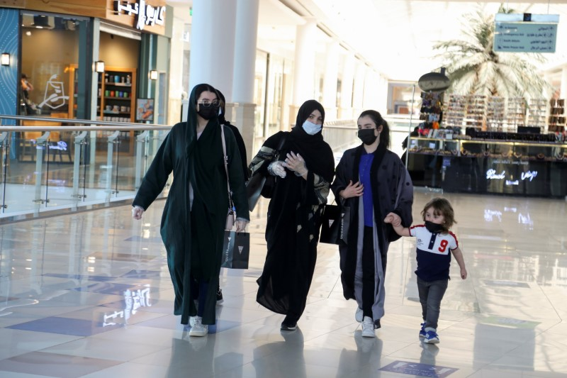 Women wear face masks as they walk at the Hayat mall after restaurants and malls reopened as the government eases the coronavirus lockdown restrictions, in Riyadh, Saudi Arabia June 1, 2020. REUTERS/Ahmed Yosri