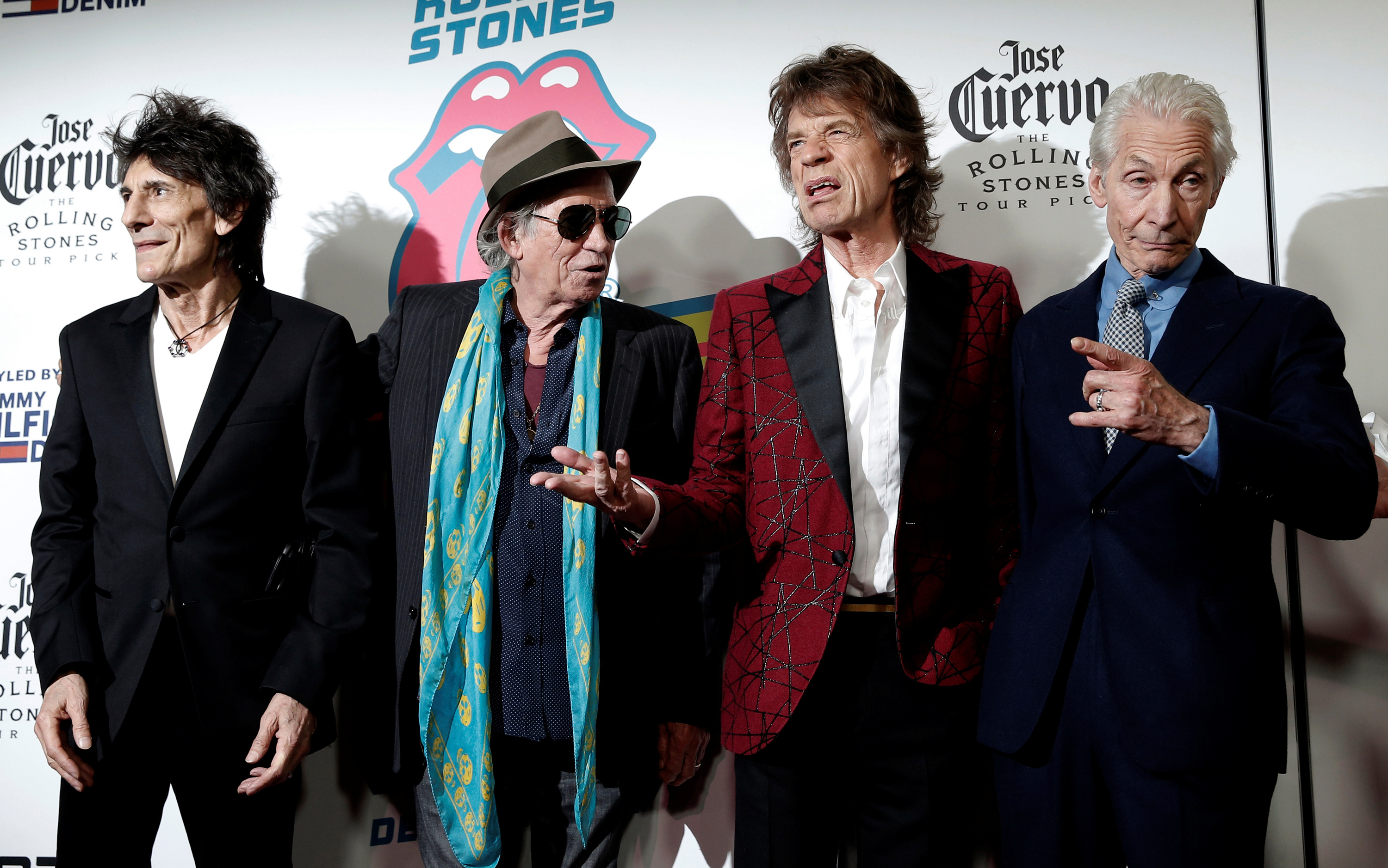 The Rolling Stones (L-R) Ronnie Wood, Keith Richards, Mick Jagger and Charlie Watts pose as they arrive for the opening of the new exhibit
