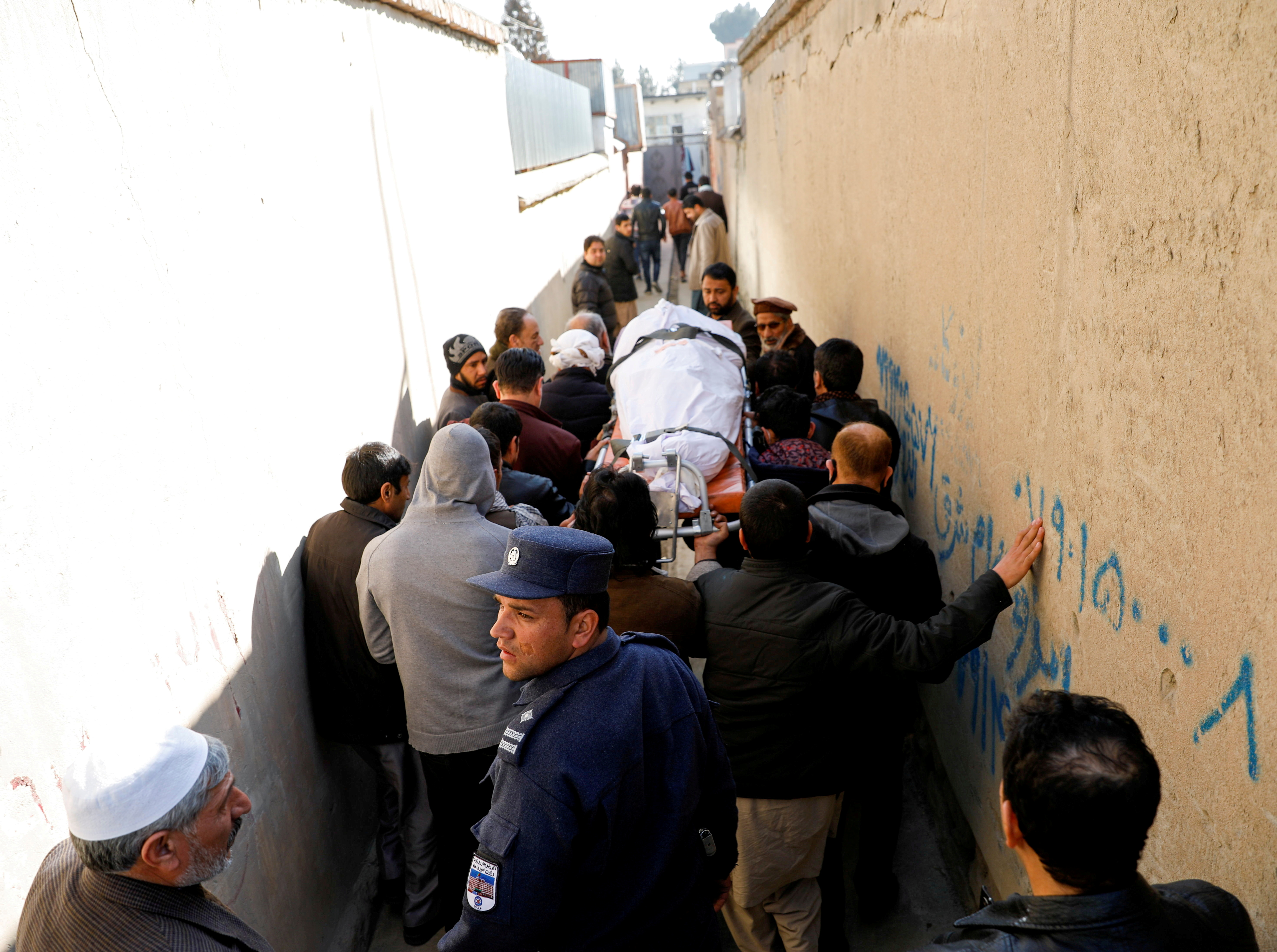 Relatives carry the body of a female judge shot dead by unknown gunmen in Kabul, Afghanistan January 17, 2021. REUTERS/Mohammad Ismail