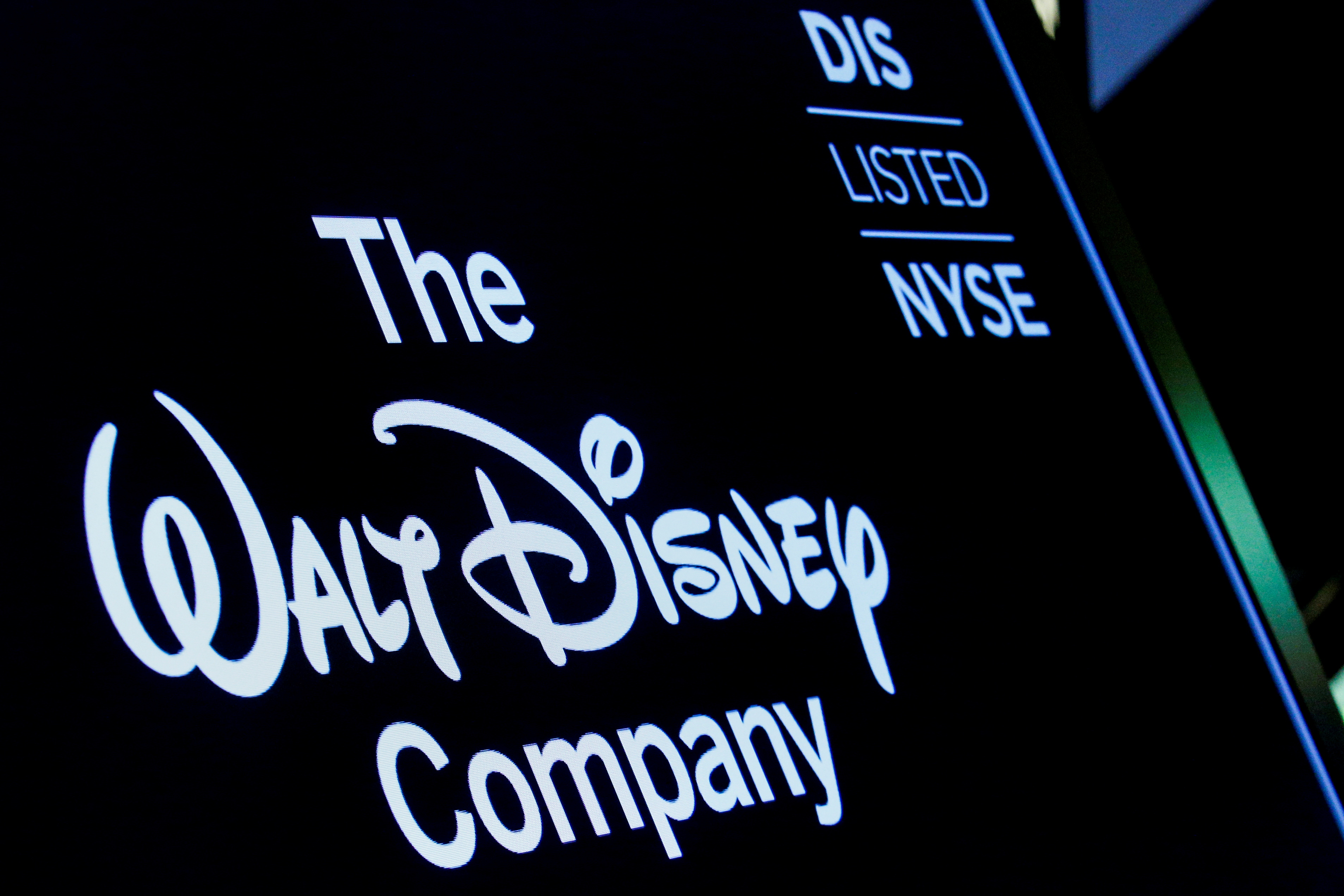 A screen shows the logo and a ticker symbol for The Walt Disney Company on the floor of the New York Stock Exchange (NYSE) in New York, U.S., December 14, 2017. REUTERS/Brendan McDermid/File Photo/File Photo