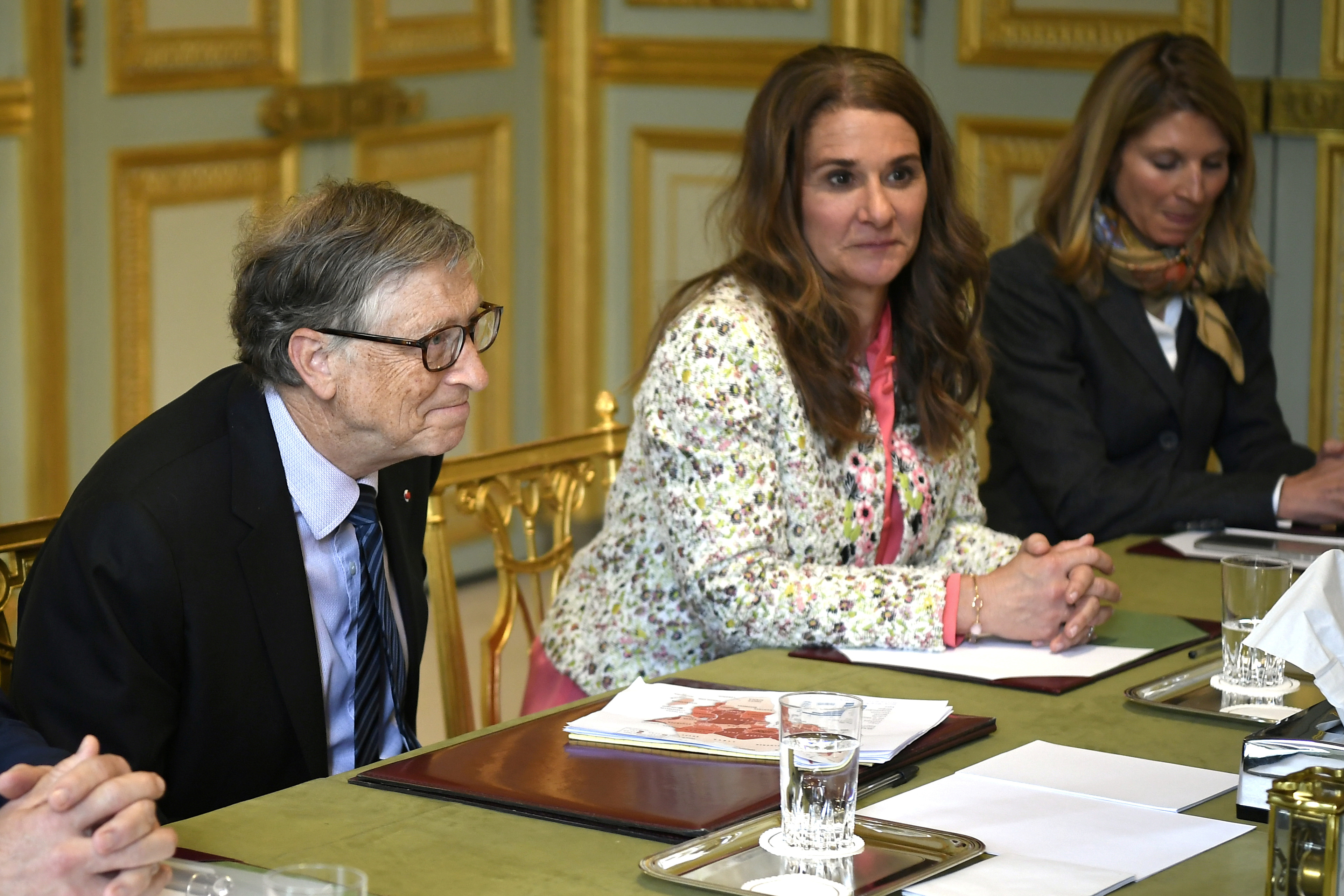 Microsoft founder and billionaire philanthropist Bill Gates (L) and his wife Melinda Gates (2ndR) attend a meeting with French President (unseen) at the Elysee Palace in Paris, France, April 16, 2018.   Lionel Bonaventure/Pool via Reuters/File Photo