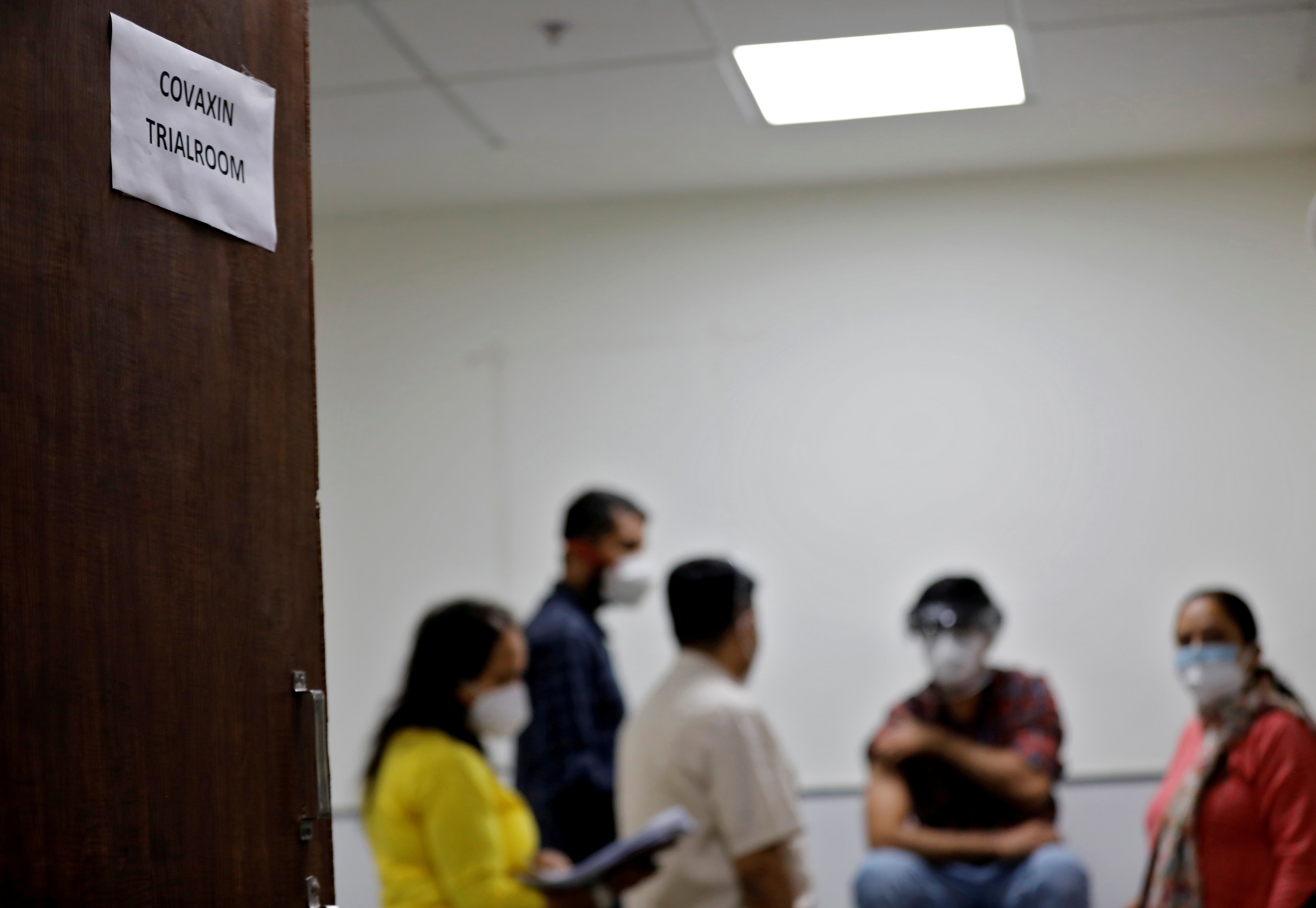 Medics prepare to administer COVAXIN, an Indian government-backed experimental COVID-19 vaccine, to a health worker during its trials, at the Gujarat Medical Education & Research Society in Ahmedabad, India, November 26, 2020. REUTERS/Amit Dave/File Photo