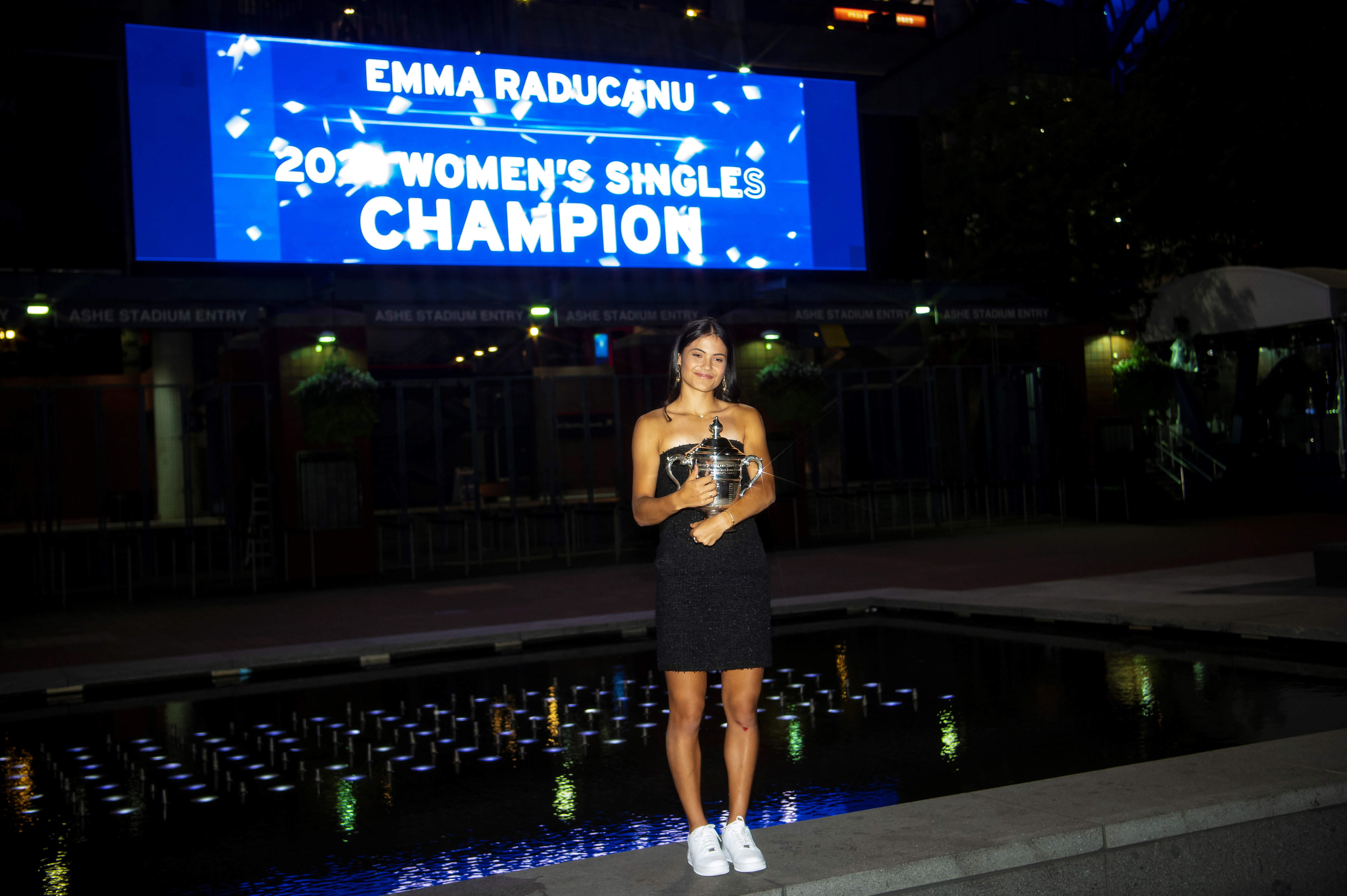 Britain's Emma Raducanu poses with the U.S. Open tennis championship trophy after her match against Leylah Fernandez of Canada in the women's singles final the 2021 U.S. Open tennis tournament at USTA Billie Jean King National Tennis Center in New York, U.S., September 11, 2021. Michael Frey/Handout via REUTERS