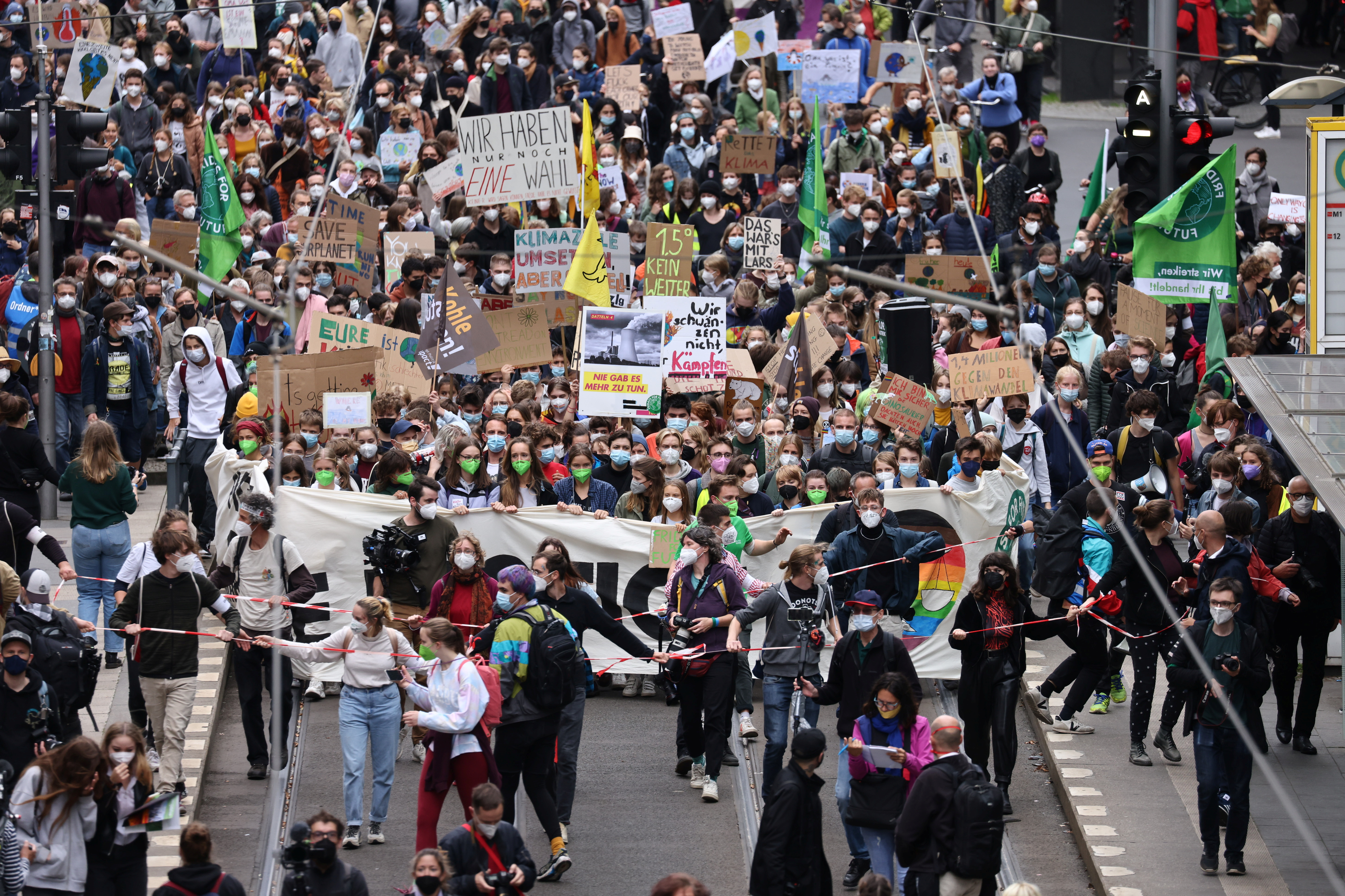 People take part in the Global Climate Strike of the movement Fridays for Future in Berlin, Germany, September 24, 2021. REUTERS/Christian Mang