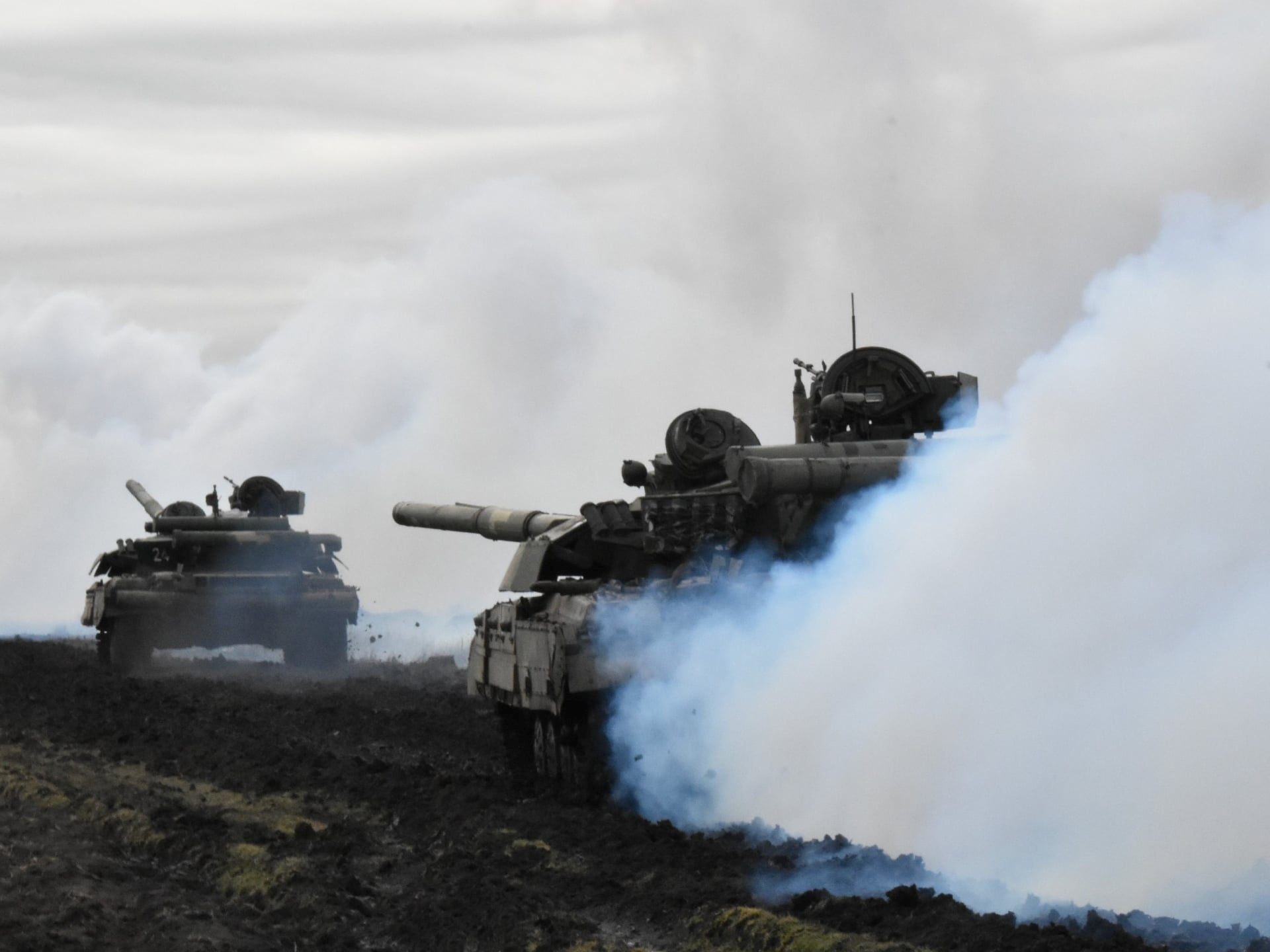 Tanks of the Ukrainian Armed Forces are seen during drills at an unknown location near the border of Russian-annexed Crimea, Ukraine, in this handout picture released by the General Staff of the Armed Forces of Ukraine press service April 14, 2021.  Press Service General Staff of the Armed Forces of Ukraine/Handout via REUTERS