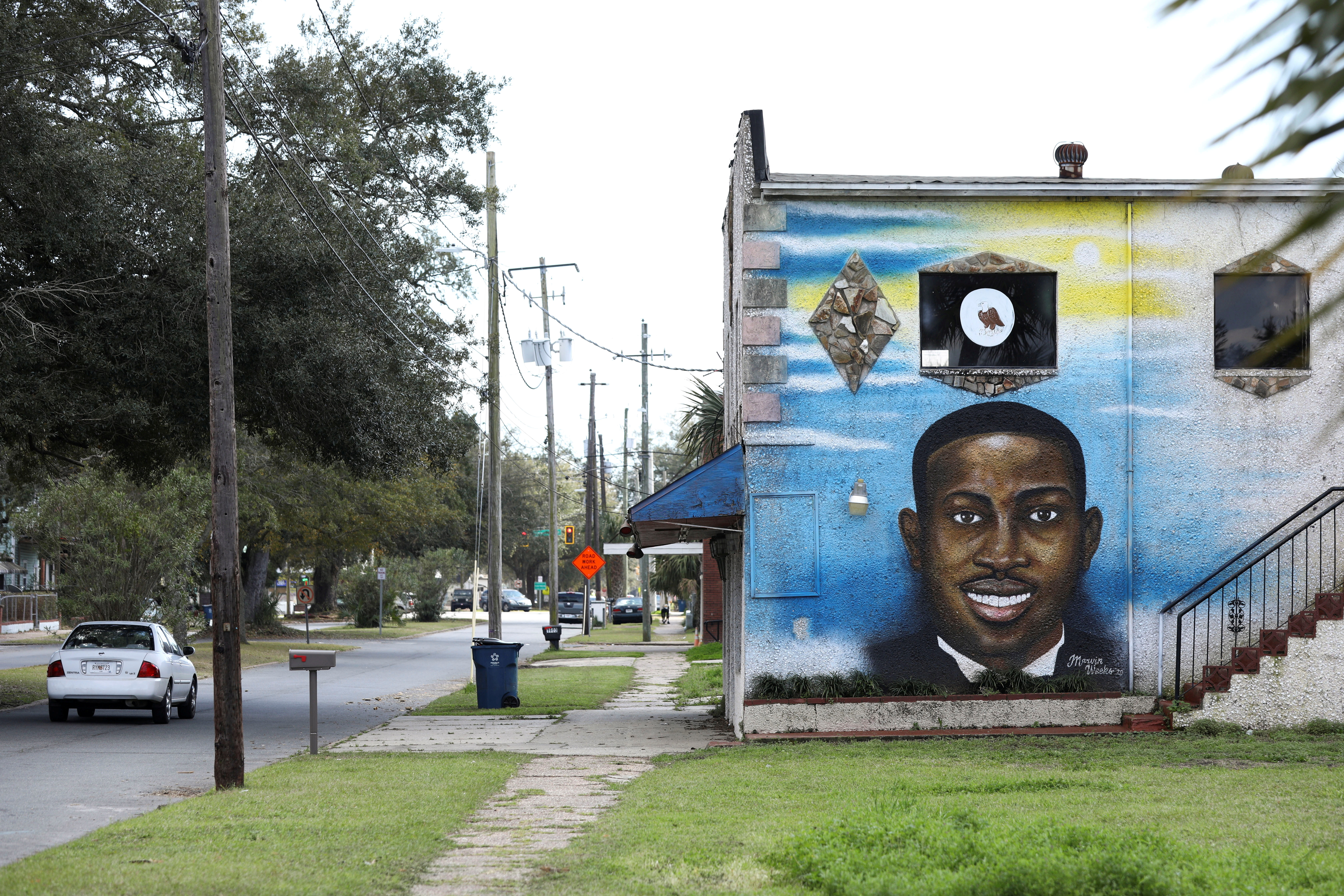 A mural depicts shot Black man Ahmaud Arbery as a Black History Month Memorial Ride is held in memory of those who have died through race-related violence, in Brunswick, Georgia, U.S., February 27, 2021. REUTERS/Dustin Chambers/File Photo