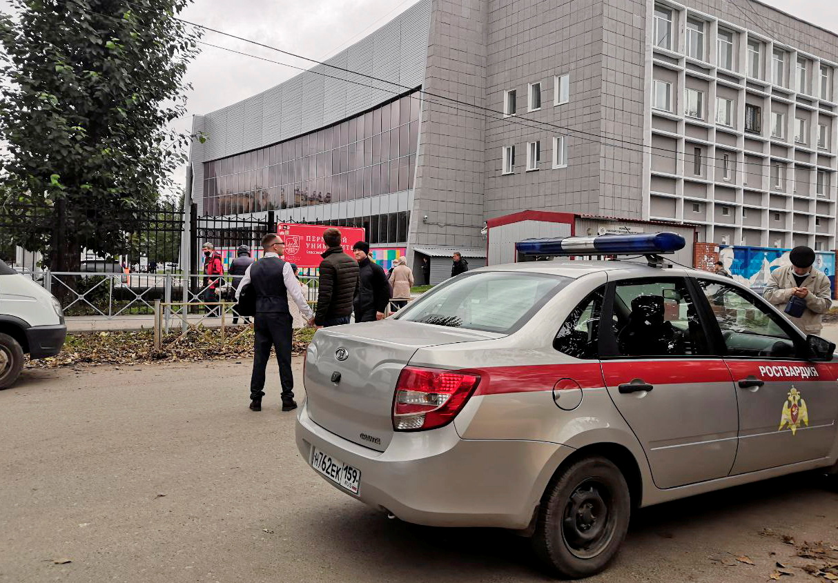A car of Russia's National Guard is seen at the scene after a gunman opened fire at the Perm State University in Perm, Russia September 20, 2021. REUTERS/Anna Vikhareva