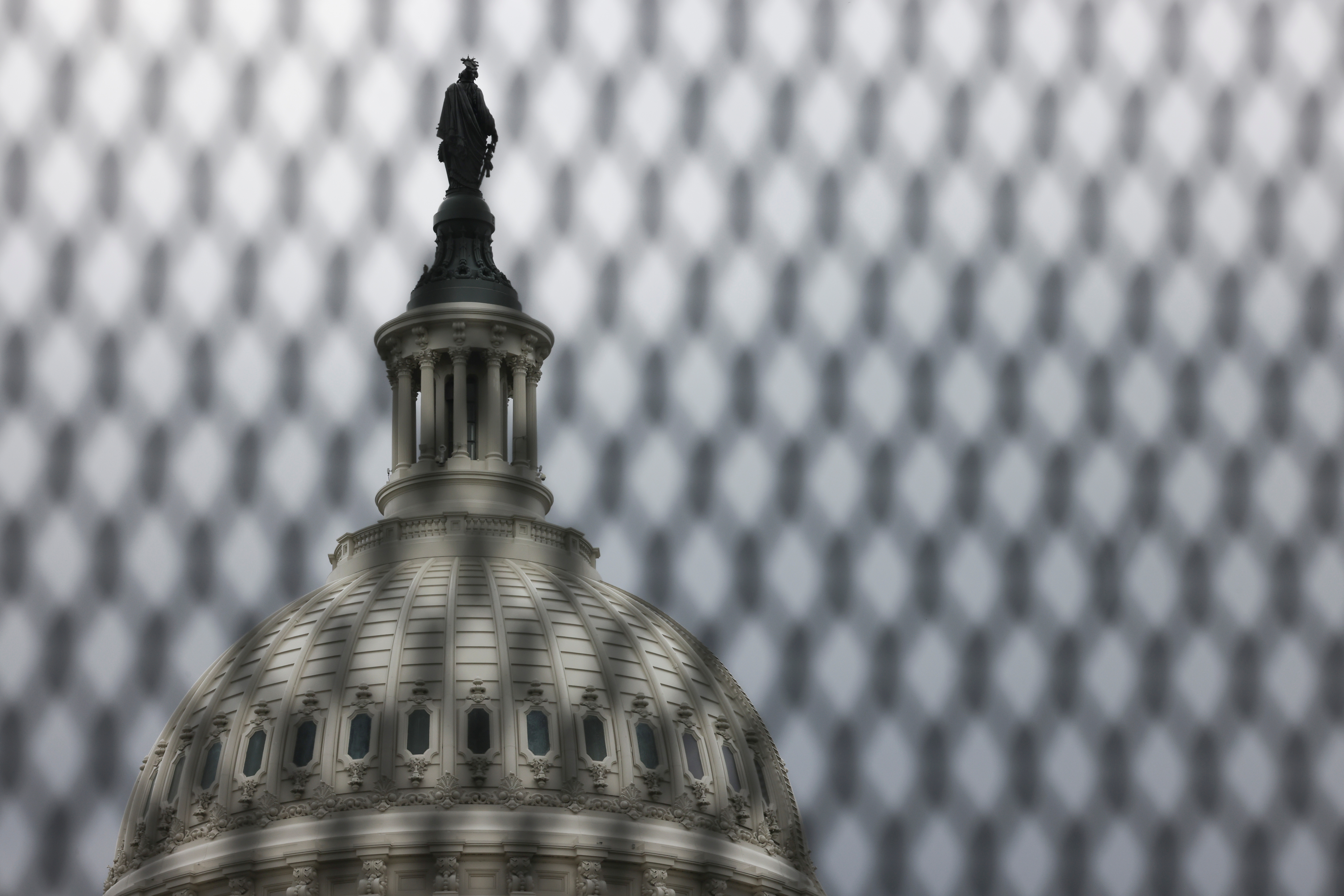 The U.S. Capitol building is seen behind security fencing that has been up around the building since shortly after the January 6, 2021 siege on Capitol Hill in Washington, May 28, 2021.  REUTERS/Evelyn Hockstein