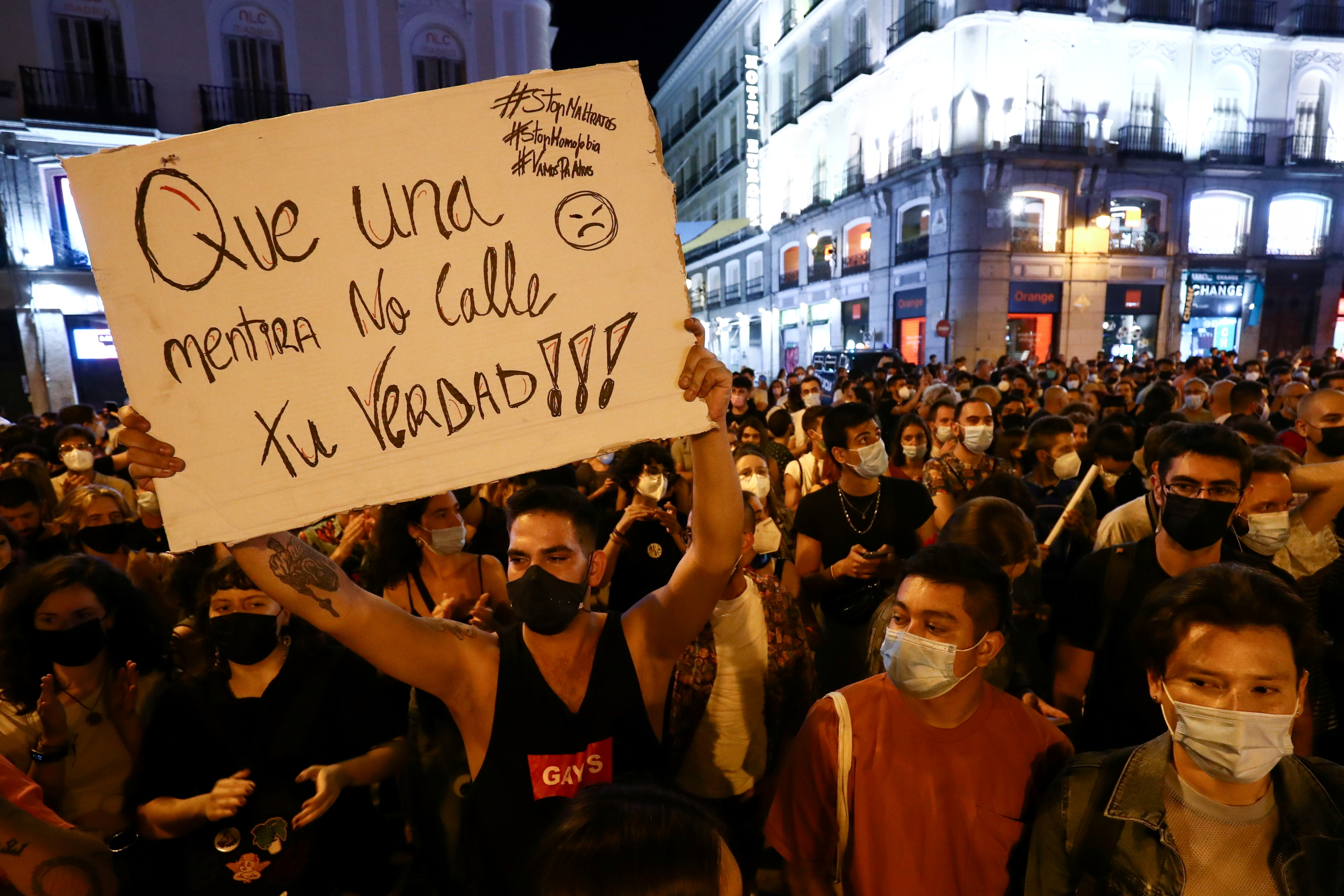 A person holds a sign as LGBTIQ activists and supporters protest against homophobic crimes, at Puerta del Sol square in Madrid, Spain, September 8, 2021. The sign reads 'Don't let a lie shut up your truth'. REUTERS/Sergio Perez