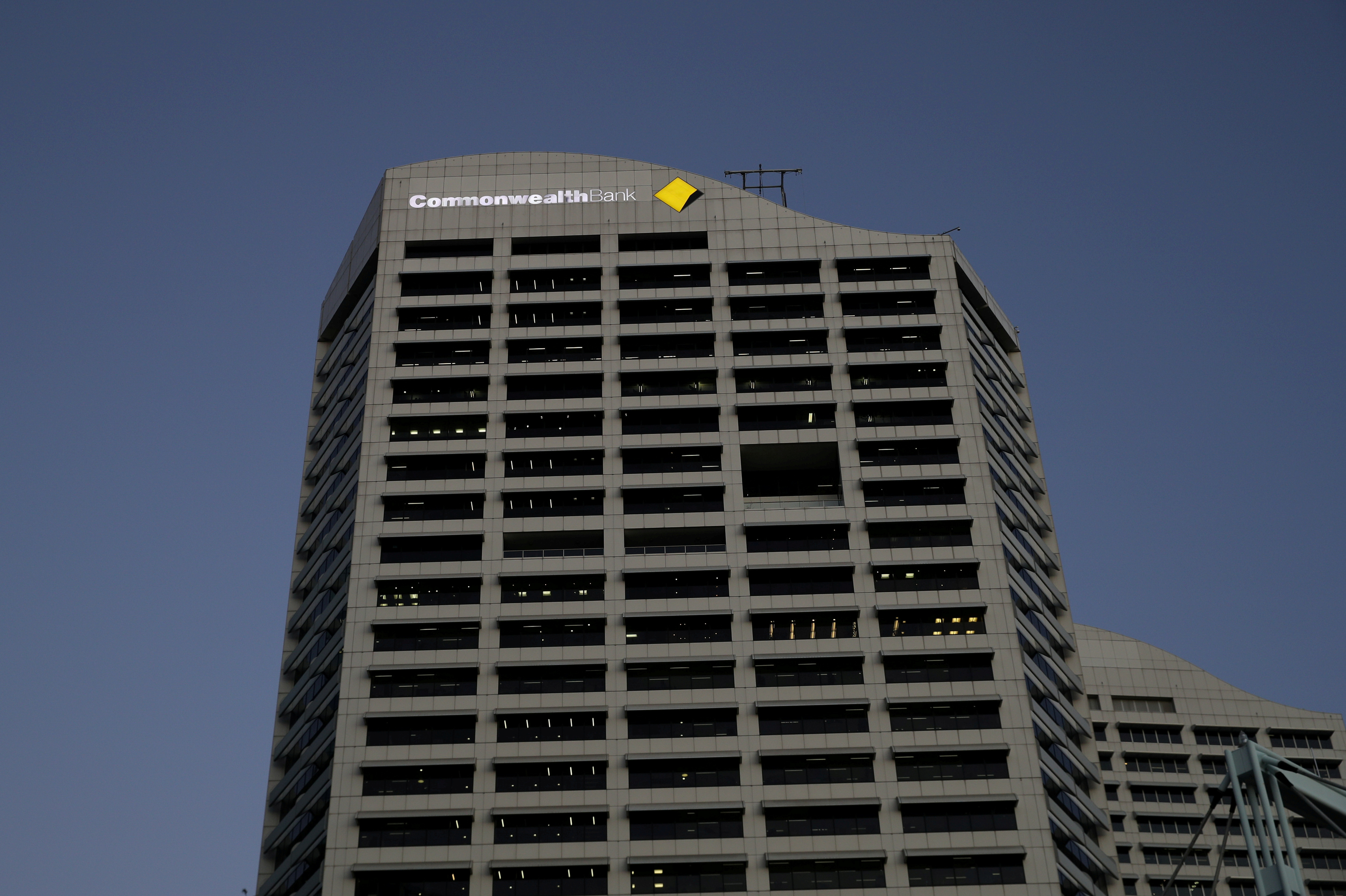 An office building with the Commonwealth Bank logo is seen amidst the easing of the coronavirus disease (COVID-19) restrictions in the Central Business District of Sydney, Australia, June 3, 2020.  REUTERS/Loren Elliott