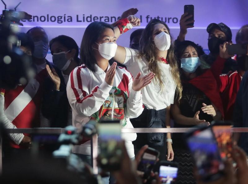 Peru's presidential candidate Keiko Fujimori (L) applauds to supporters while leading a demonstration in Lima, Peru June 12, 2021. REUTERS/Sebastian Castaneda