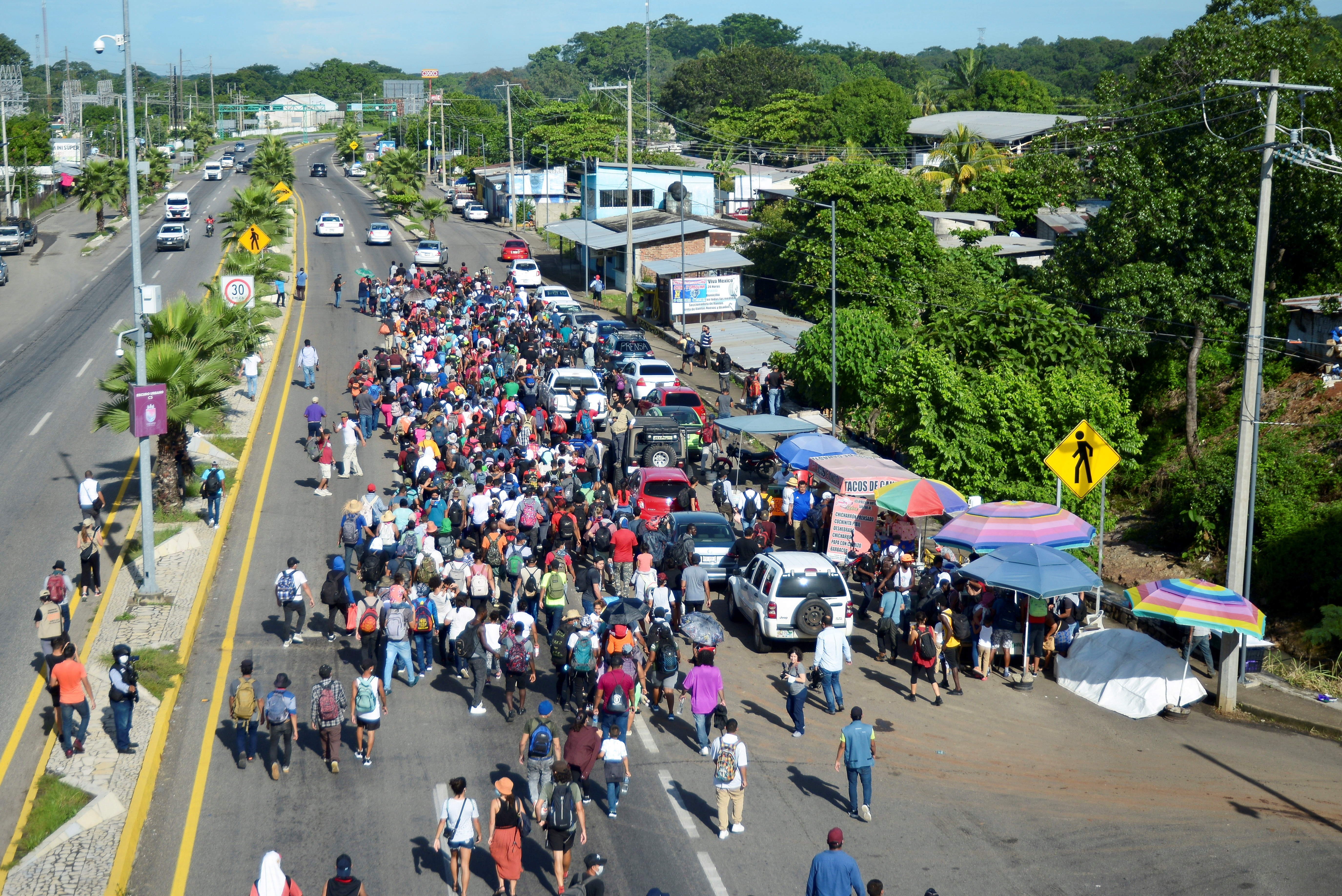 Migrants and asylum seekers from Central America and the Caribbean walk in a caravan heading to the U.S., in Tapachula, Chiapas state, Mexico September 4, 2021. REUTERS/Jacob Garcia