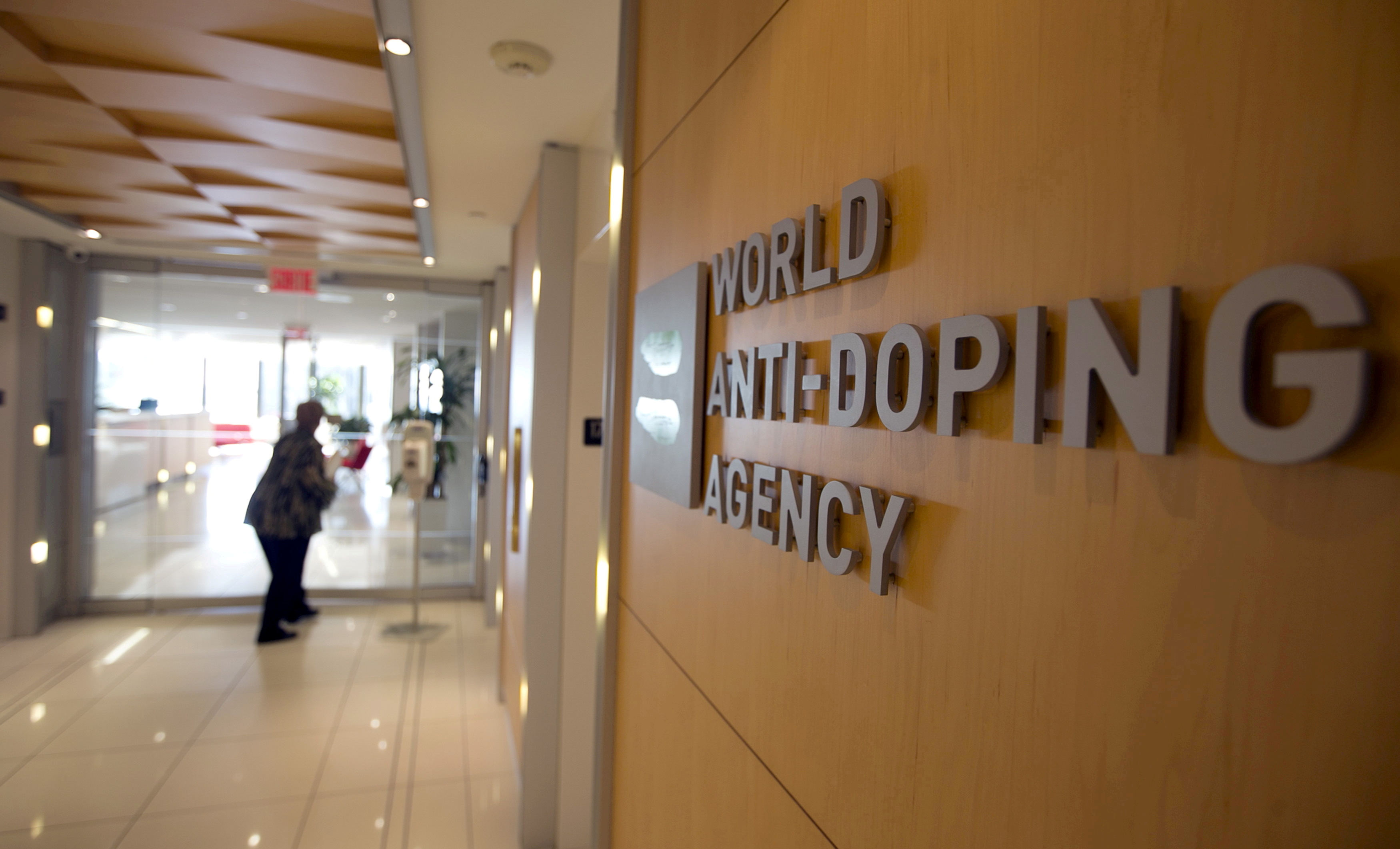 A woman walks into the head office of the World Anti-Doping Agency (WADA) in Montreal, Quebec, Canada November 9, 2015.  REUTERS/Christinne Muschi