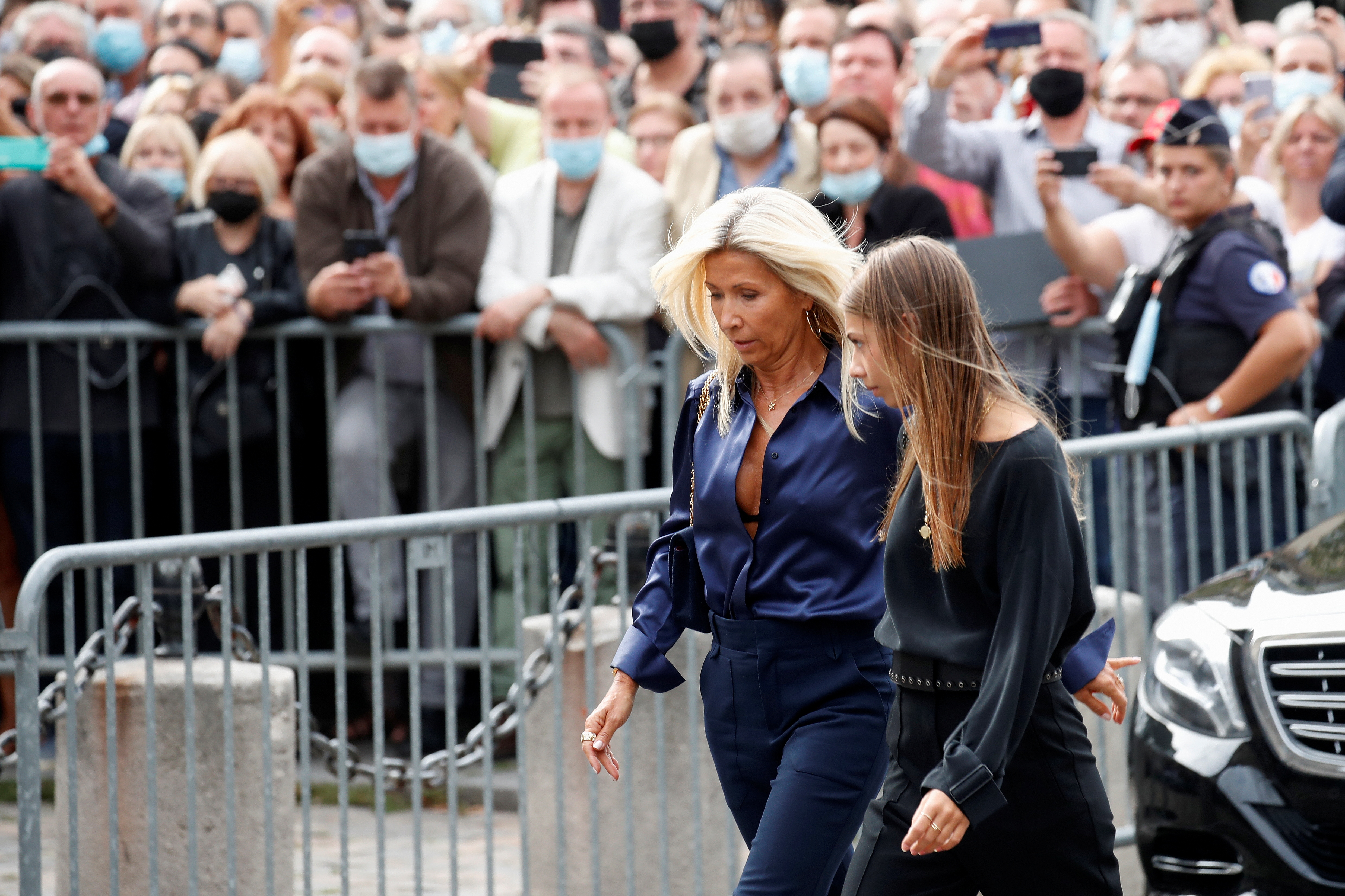 Stella Belmondo, daughter of Jean-Paul Belmondo, and her mother Natty Tardivel arrive to attend the funeral ceremony for late French actor Jean-Paul Belmondo at the Saint-Germain-des-Pres church in Paris, France, September 10, 2021. REUTERS/Gonzalo Fuentes