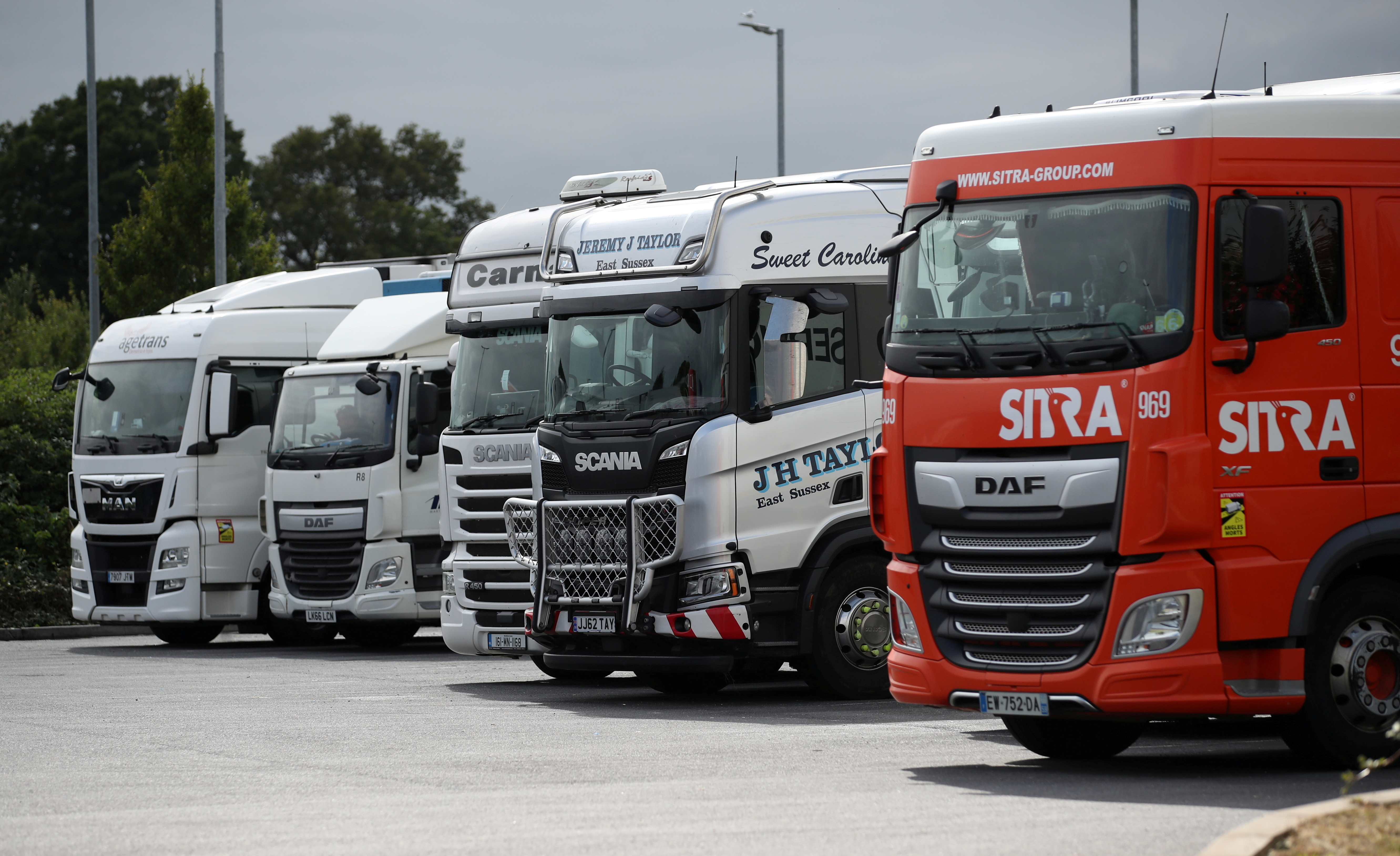 Lorries are seen at an HGV parking, at Cobham services on the M25 motorway, Cobham, Britain, August 31, 2021. REUTERS/Peter Cziborra