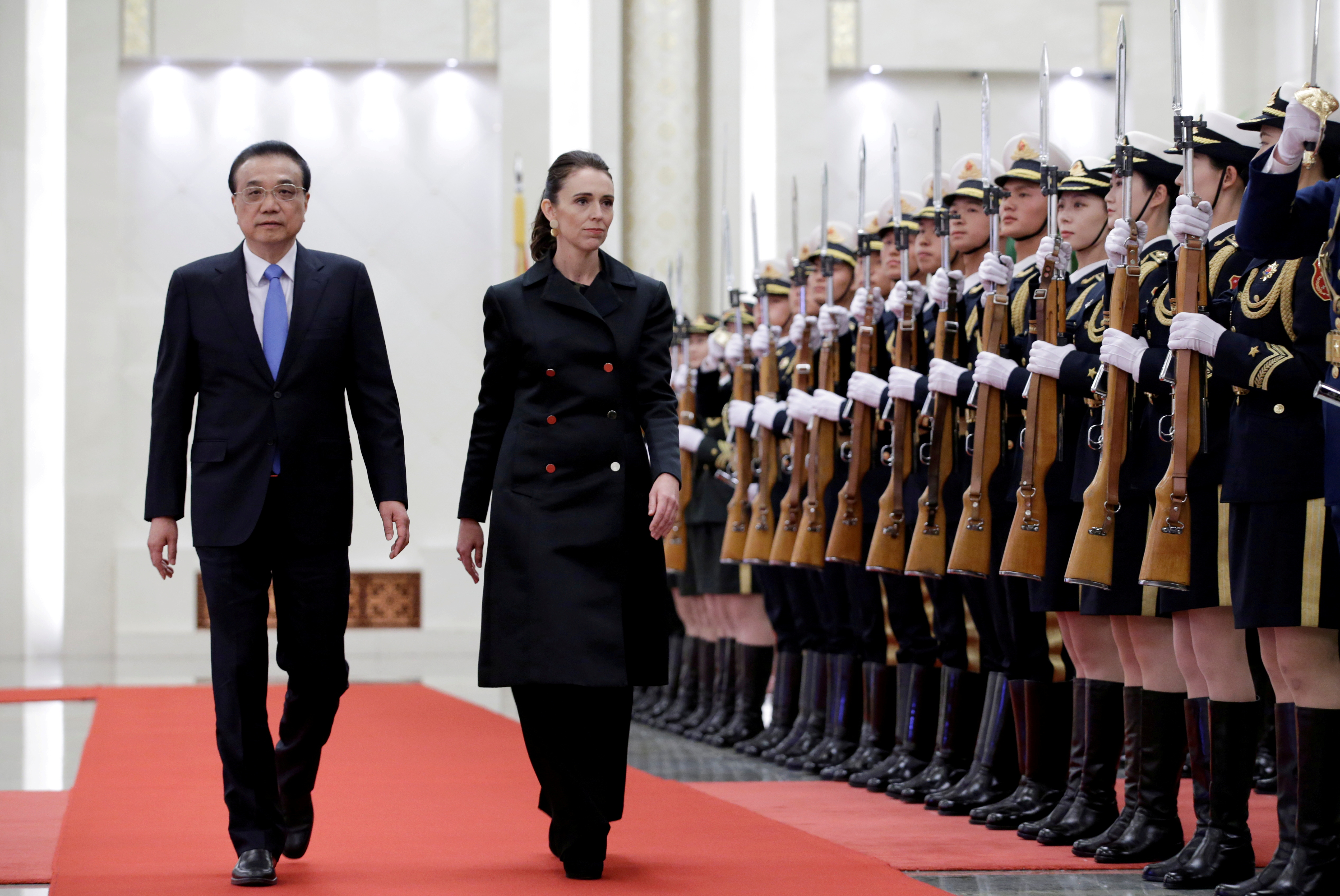 New Zealand Prime Minister Jacinda Ardern (R) and China's Premier Li Keqiang attend a welcome ceremony at the Great Hall of the People in Beijing, China, April 1, 2019. REUTERS/Jason Lee/