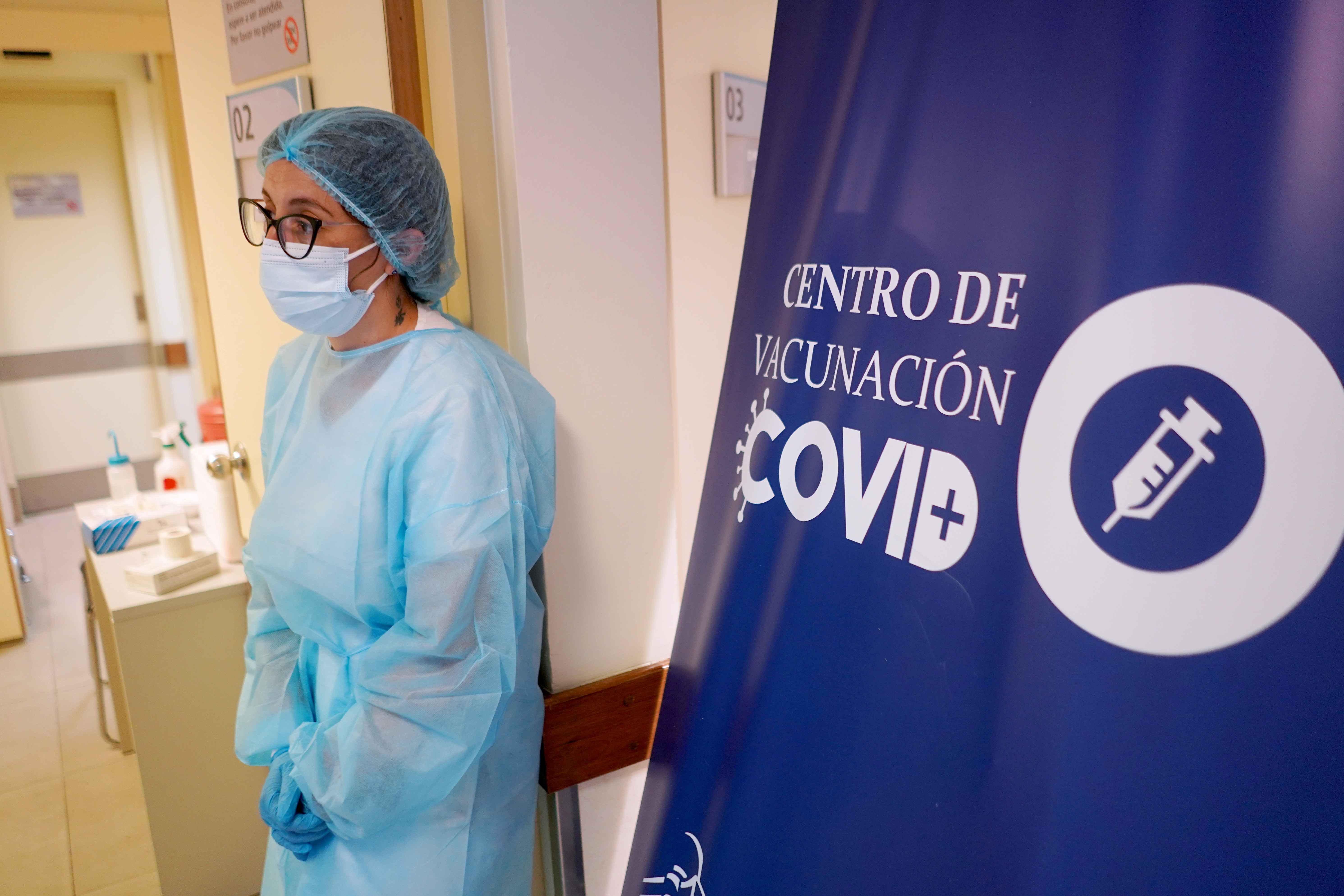 A healthcare worker stands during the first stage of COVID-19 vaccination plan, which aims to inoculate teachers, military personnel, firefighters and police officers, among other non medical essential workers, at a vaccination center in Antel Arena, Montevideo, Uruguay March 1, 2021. REUTERS/Mariana Greif