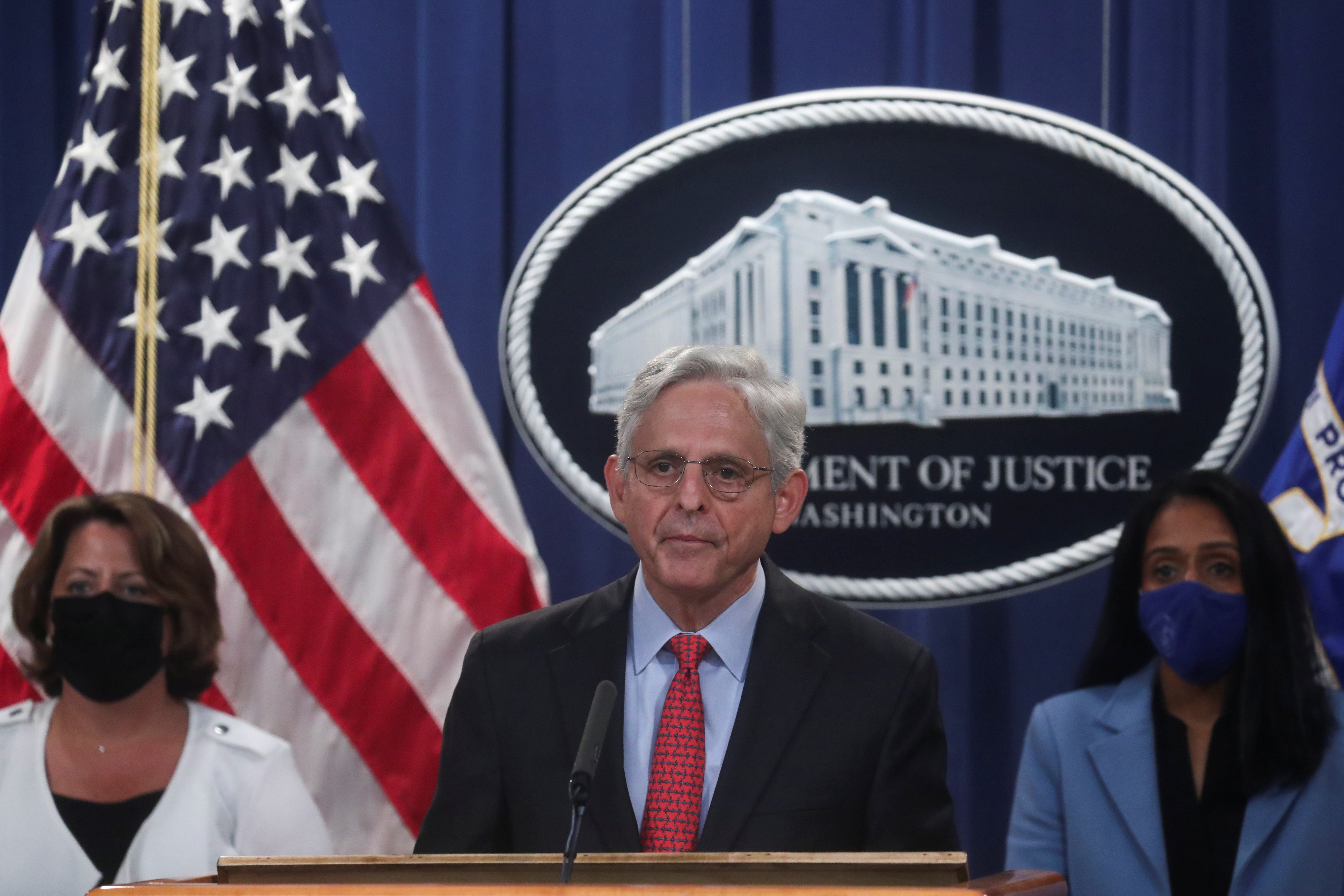 U.S. Attorney General Merrick Garland, accompanied by Deputy Attorney General Lisa Monaco and Associate Attorney General Vanita Gupta, announces a civil lawsuit to sue Texas over its abortion law, during a news conference at the Justice Department in Washington, D.C., U.S., September 9, 2021. REUTERS/Leah Millis