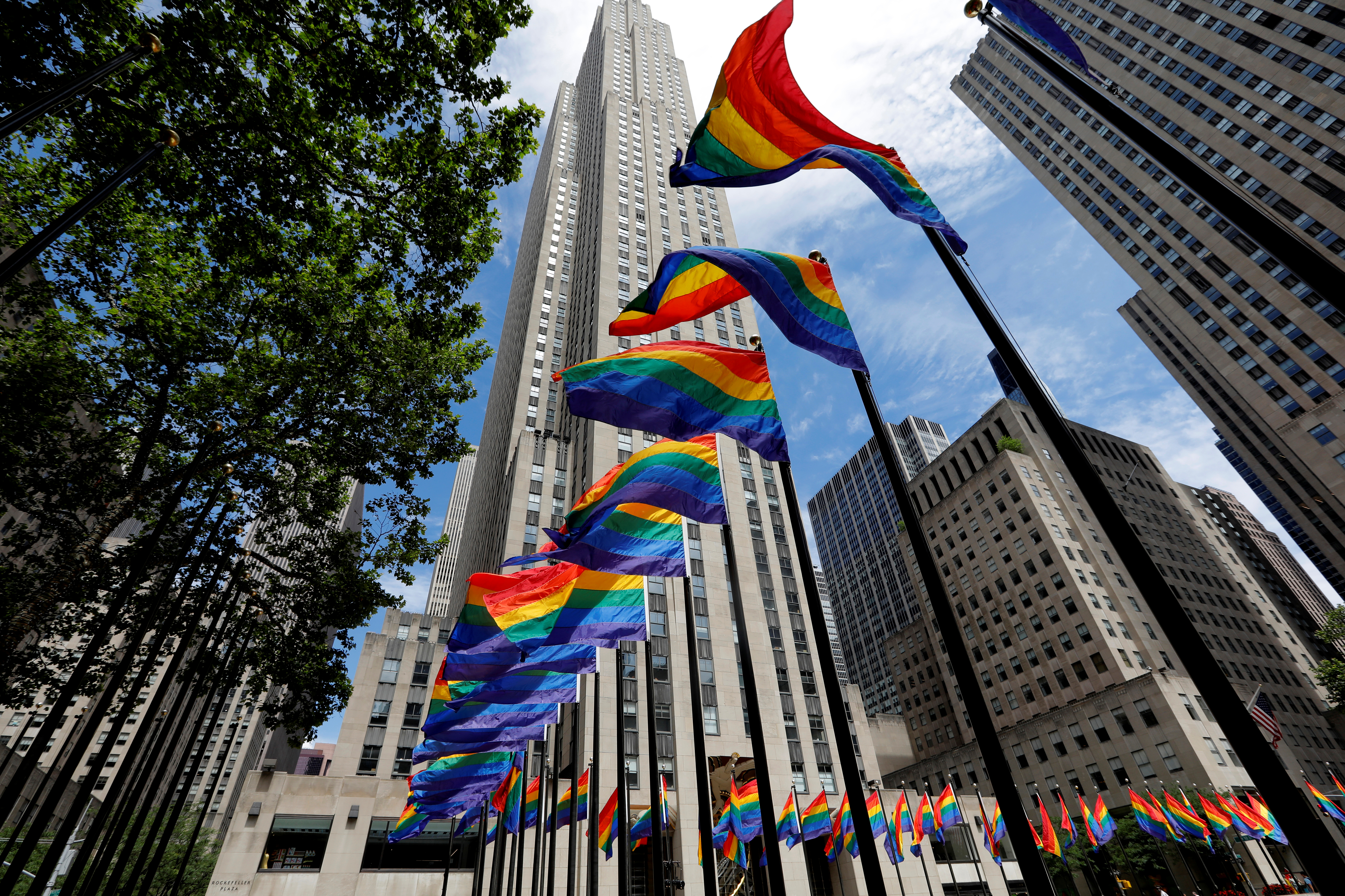 Rainbow flags fly at Rockefeller Center in midtown Manhattan in support of the LGBT community, prior to the 51st anniversary of the Stonewall Uprising, in New York City, New York, U.S., June 26, 2020. REUTERS/Mike Segar