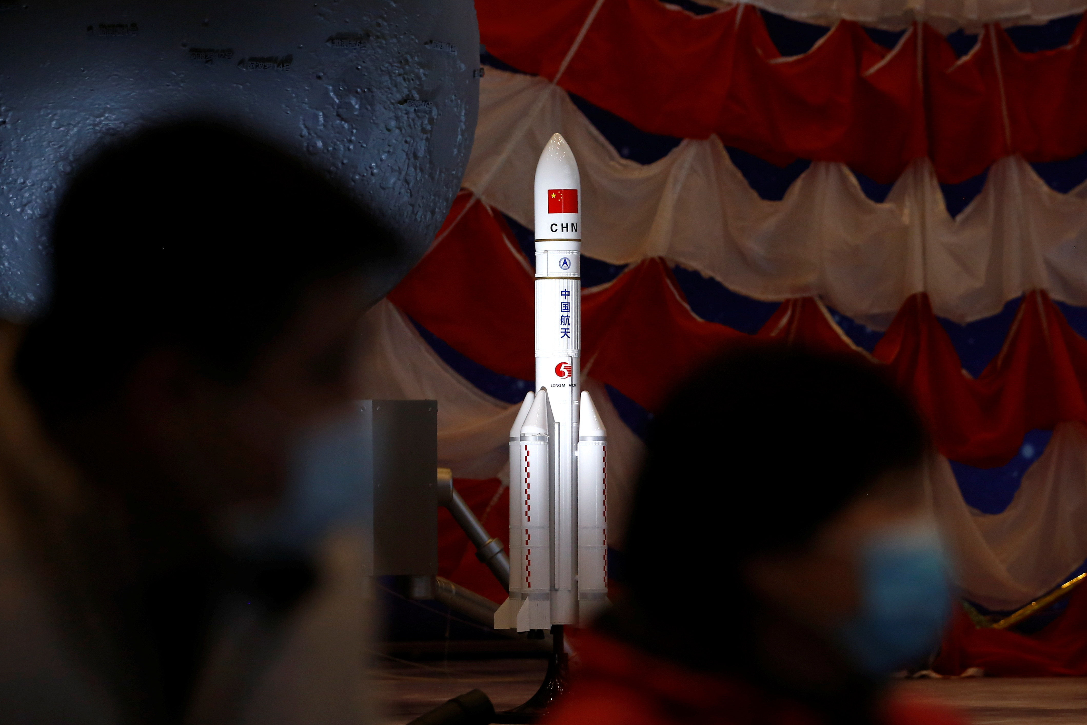 A model of the Long March-5 Y5 rocket from China's lunar exploration program Chang'e-5 Mission is displayed at an exhibition inside the National Museum in Beijing, China March 3, 2021. REUTERS/Tingshu Wang
