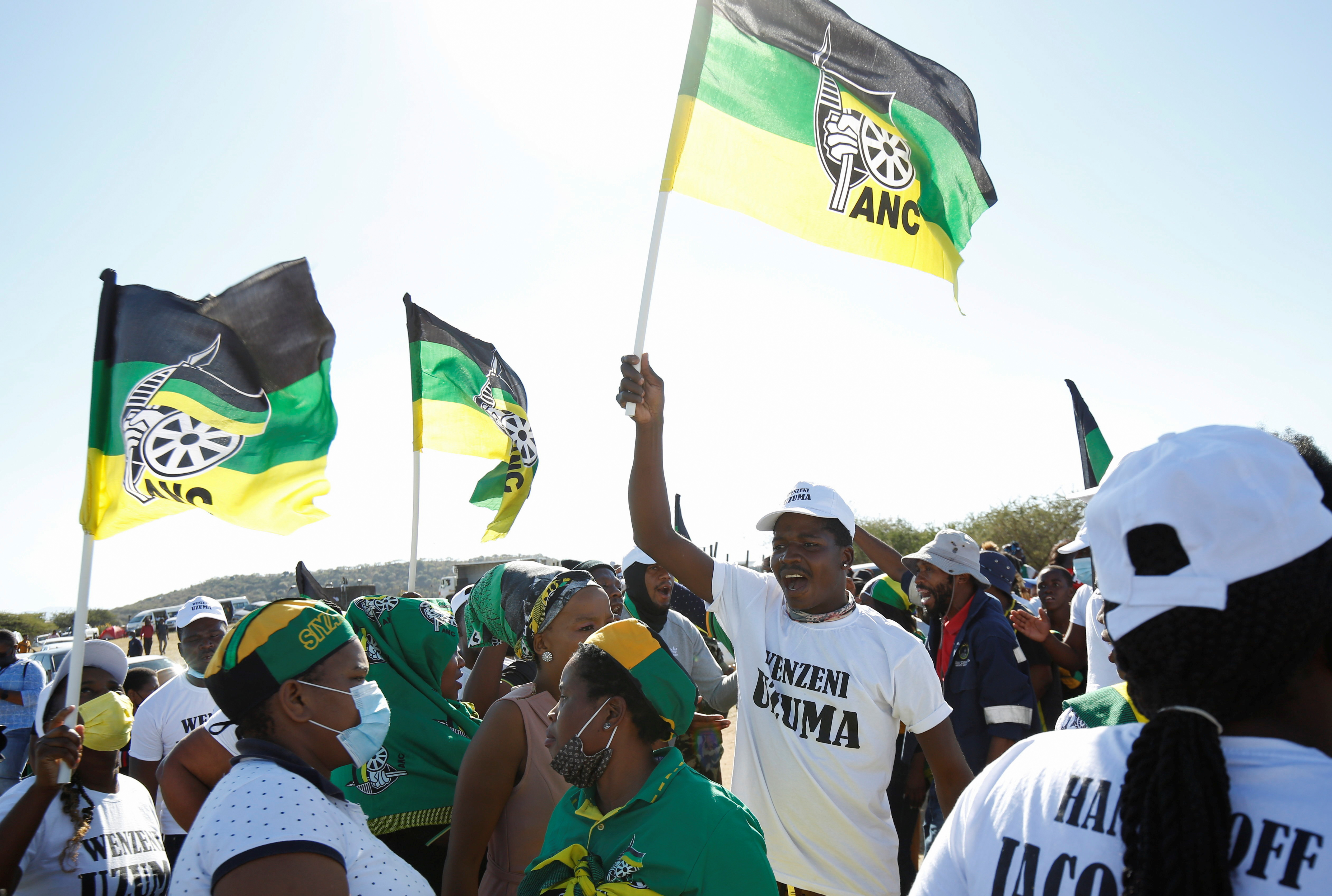 Supporters of former South African President Jacob Zuma, who was sentenced to a 15-month imprisonment by the Constitutional Court, sing and dance in front of his home in Nkandla, South Africa, July 3, 2021. REUTERS/Rogan Ward