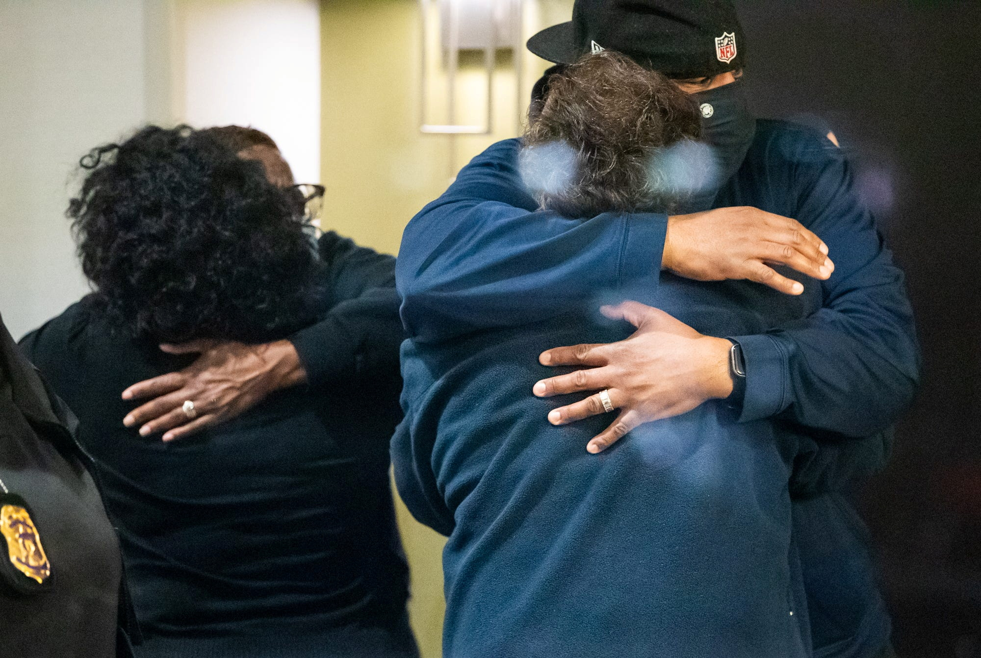 People embrace after learning that their loved one was safe after a mass casualty shooting at the FedEx facility in Indianapolis, Indiana, U.S. April 16, 2021. Mykal McEldowney/IndyStar/USA Today Network via REUTERS.
