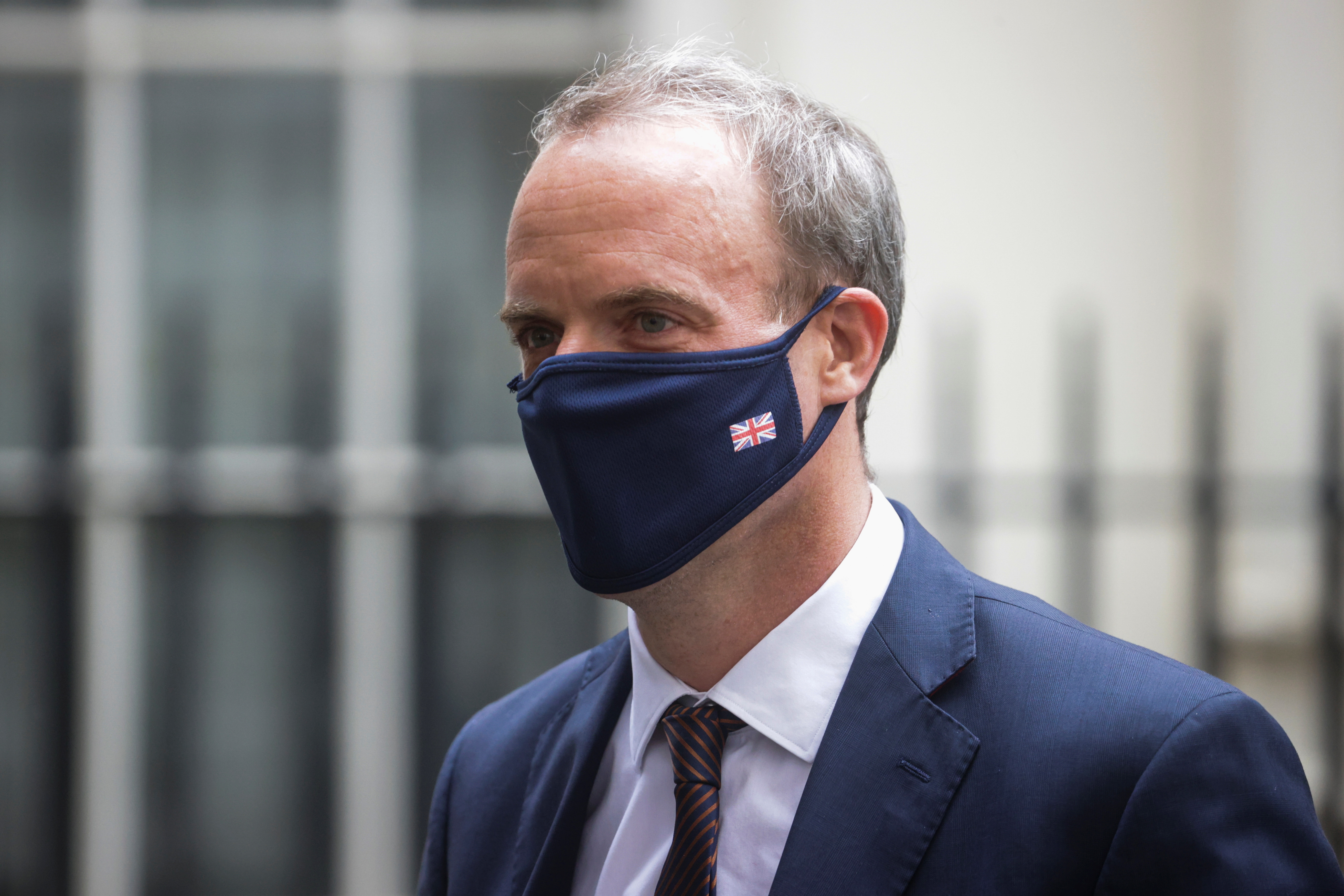 Britain's Foreign Secretary Dominic Raab walks outside Downing Street, in London, Britain, August 16, 2021. REUTERS/Hannah McKay
