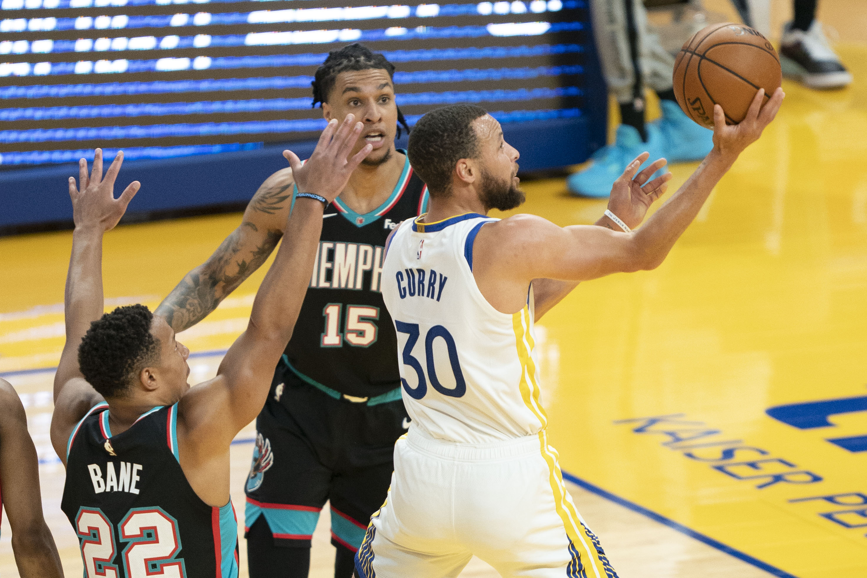 May 16, 2021; San Francisco, California, USA; Golden State Warriors guard Stephen Curry (30) shoots the basketball against Memphis Grizzlies guard Desmond Bane (22) and forward Brandon Clarke (15) during the first quarter at Chase Center. Mandatory Credit: Kyle Terada-USA TODAY Sports
