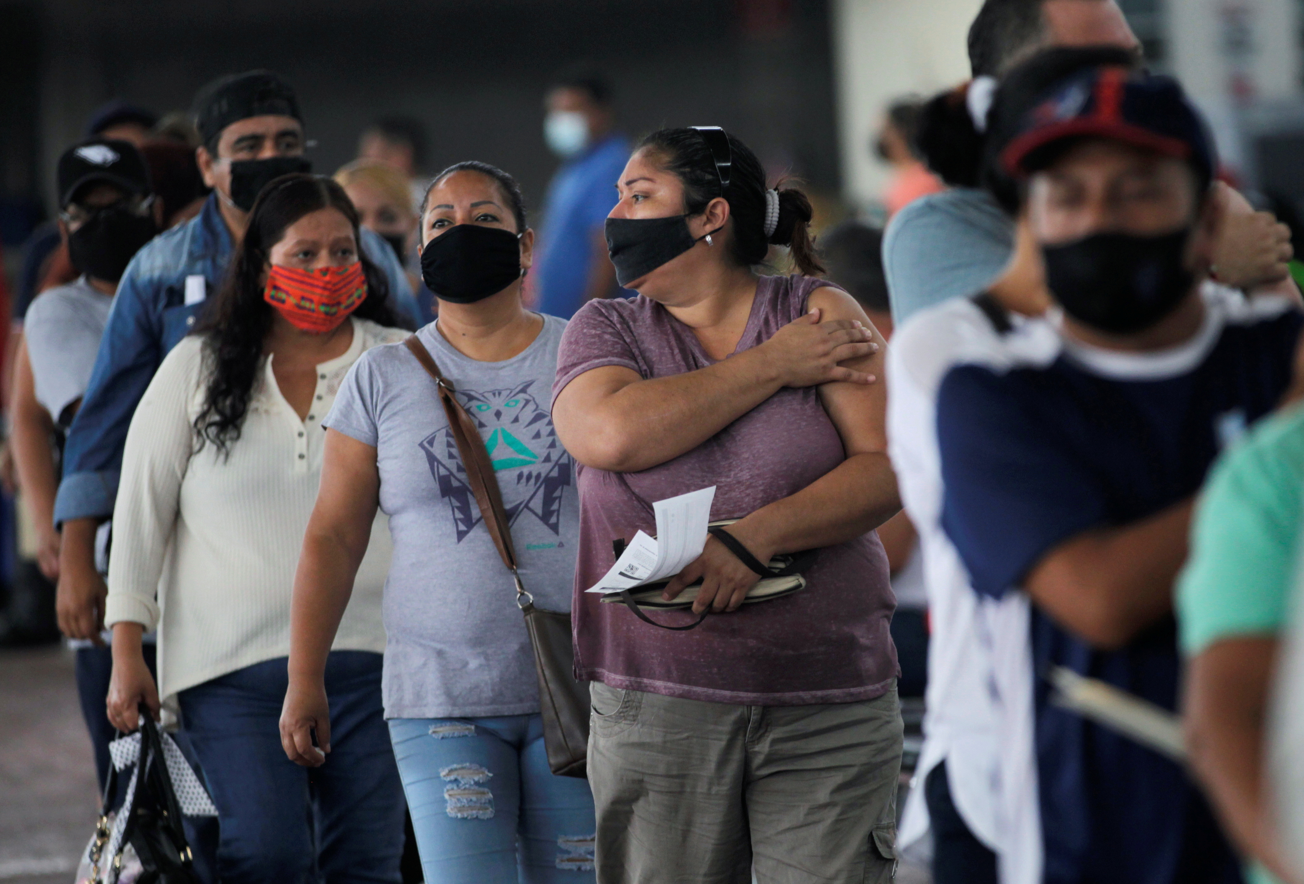 People are seen after receiving  a dose of AstraZeneca coronavirus disease (COVID-19) vaccine, during a mass vaccination in Guadalupe, on the outskirts of Monterrey, Mexico July 22, 2021. REUTERS/Daniel Becerril/File Photo