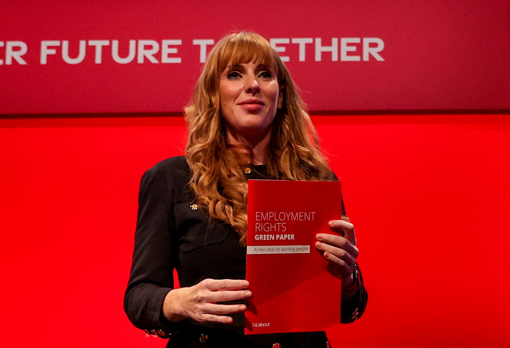 Britain's Labour Party Deputy Leader Angela Rayner holds the