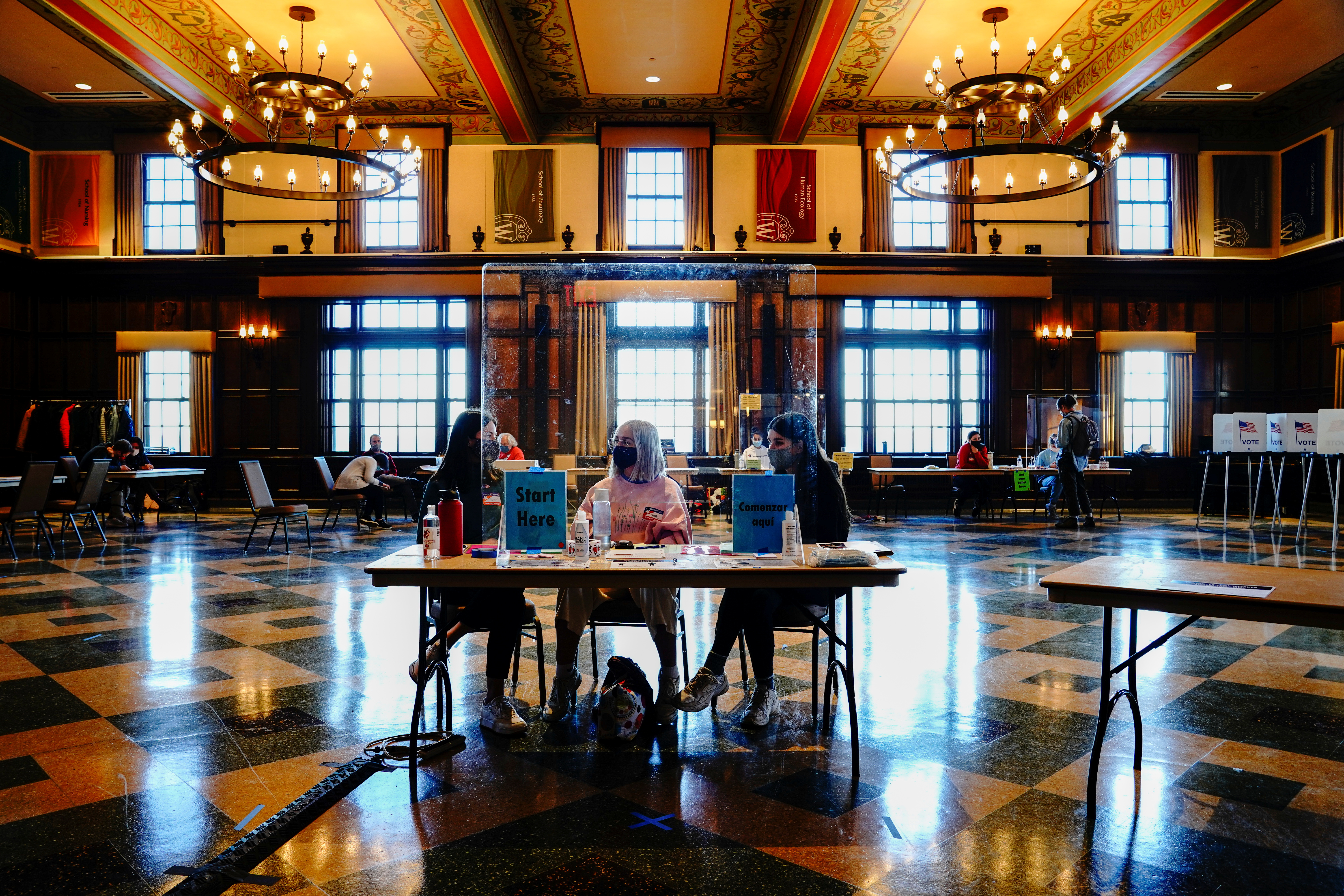 University of Wisconsin-Madison students work as poll workers at a voting site at Tripp Commons inside the Memorial Union building on the UW-Madison campus on Election Day in Madison, Dane County, Wisconsin, U.S. November 3, 2020. REUTERS/Bing Guan