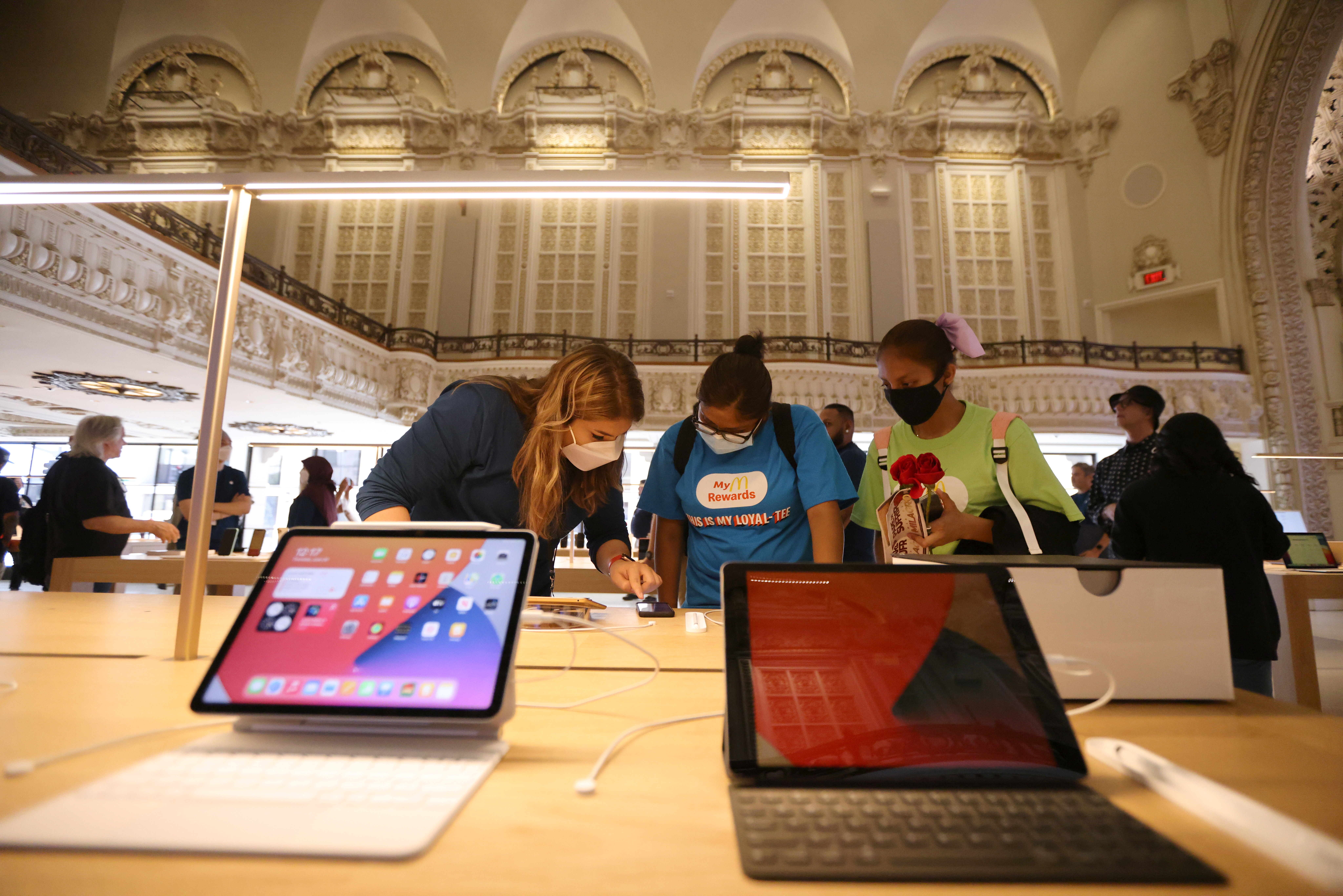 Customers browse products at the new Apple Store on Broadway in downtown Los Angeles, California, U.S., June 24, 2021. REUTERS/Lucy Nicholson