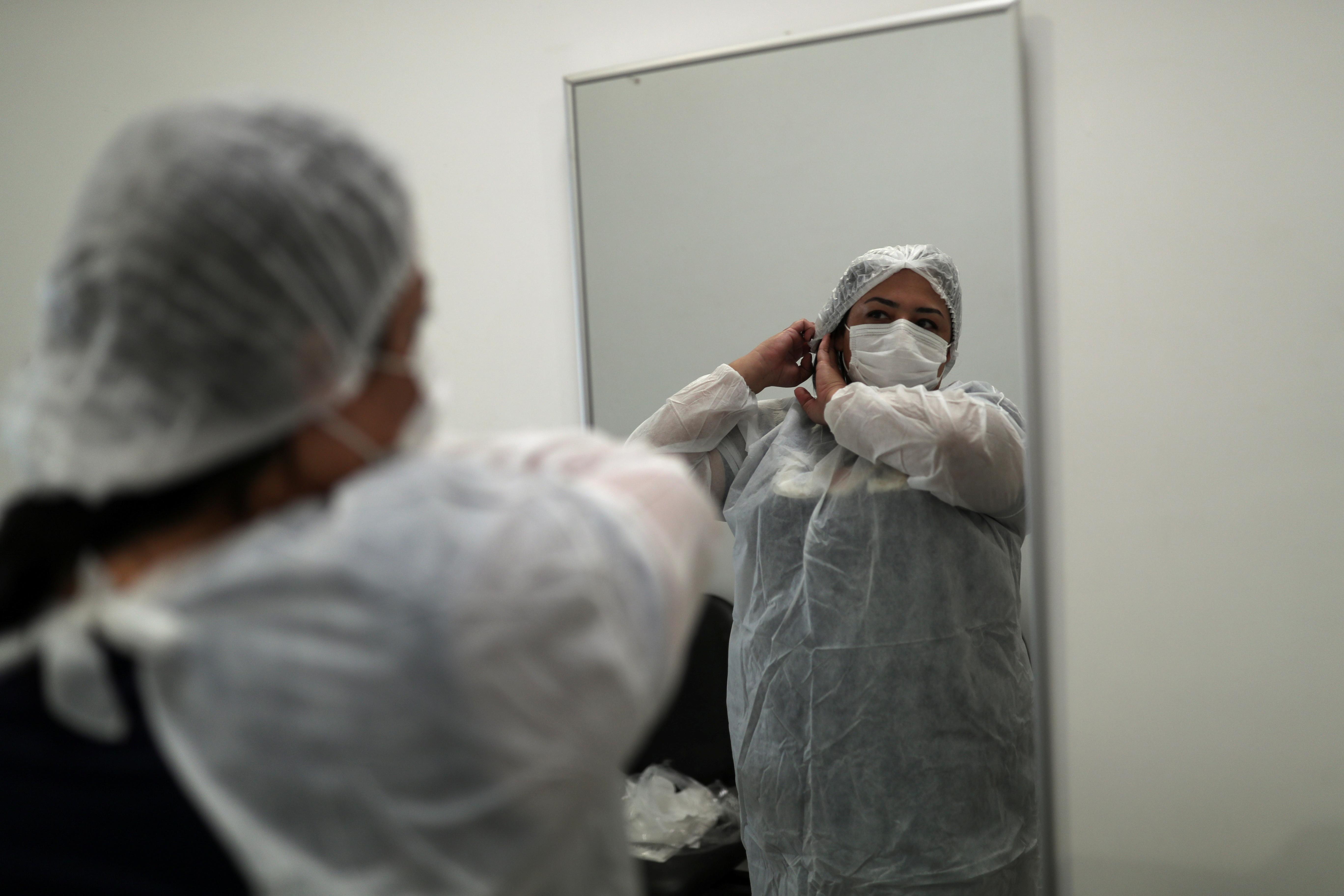 Nursing technician Semei Araujo Cunha prepares herself to enter the coronavirus disease (COVID-19) ward at a UPA (Emergency Service Unit) in Sao Carlos, Sao Paulo state, Brazil April 16, 2021. REUTERS/Amanda Perobelli