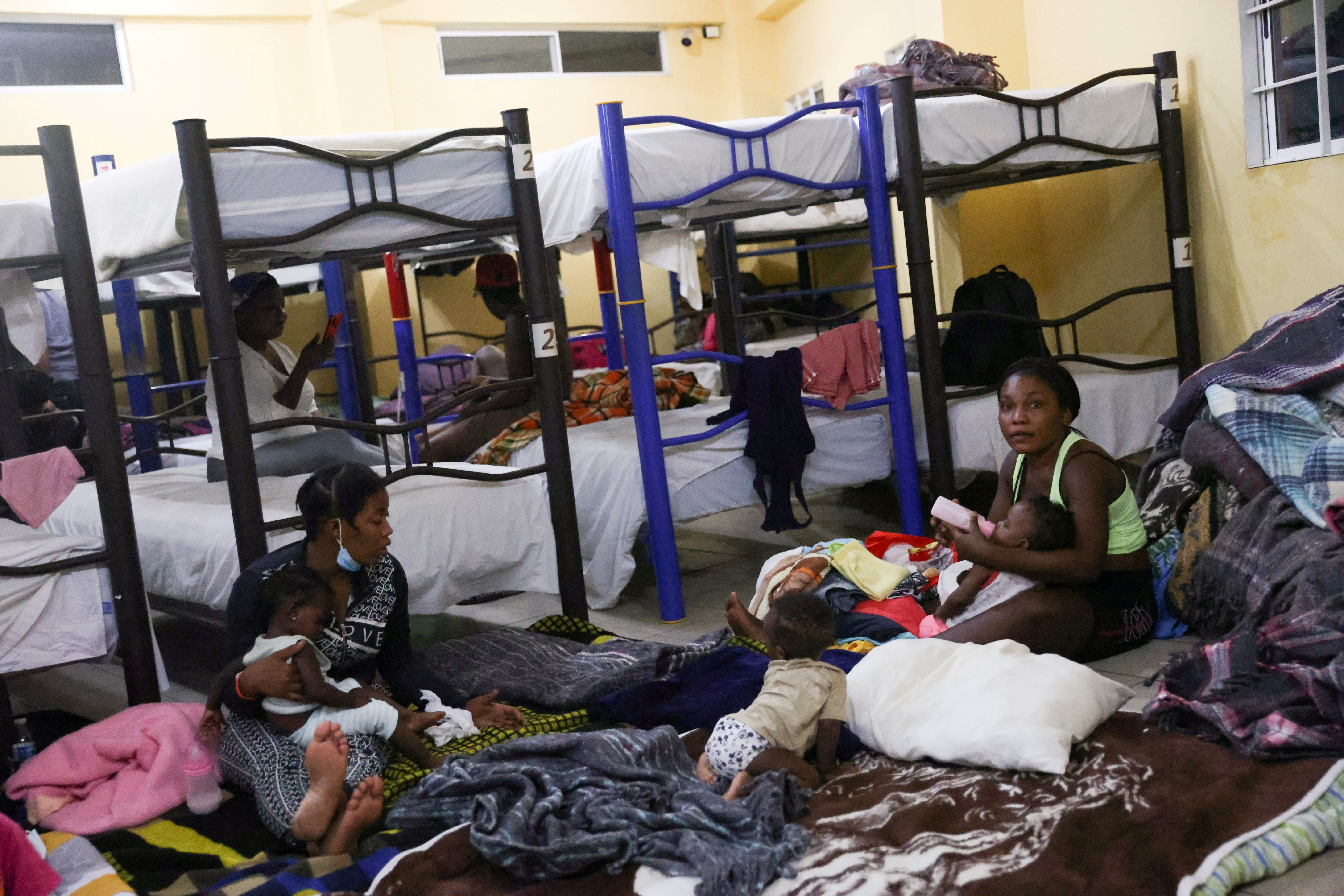 Migrants from Haiti rest in a shelter after they arrived en masse at the U.S. border and thousands of their compatriots were cleared from a frontier camp, in Monterrey, Mexico September 24, 2021. REUTERS/Edgard Garrido/File Photo