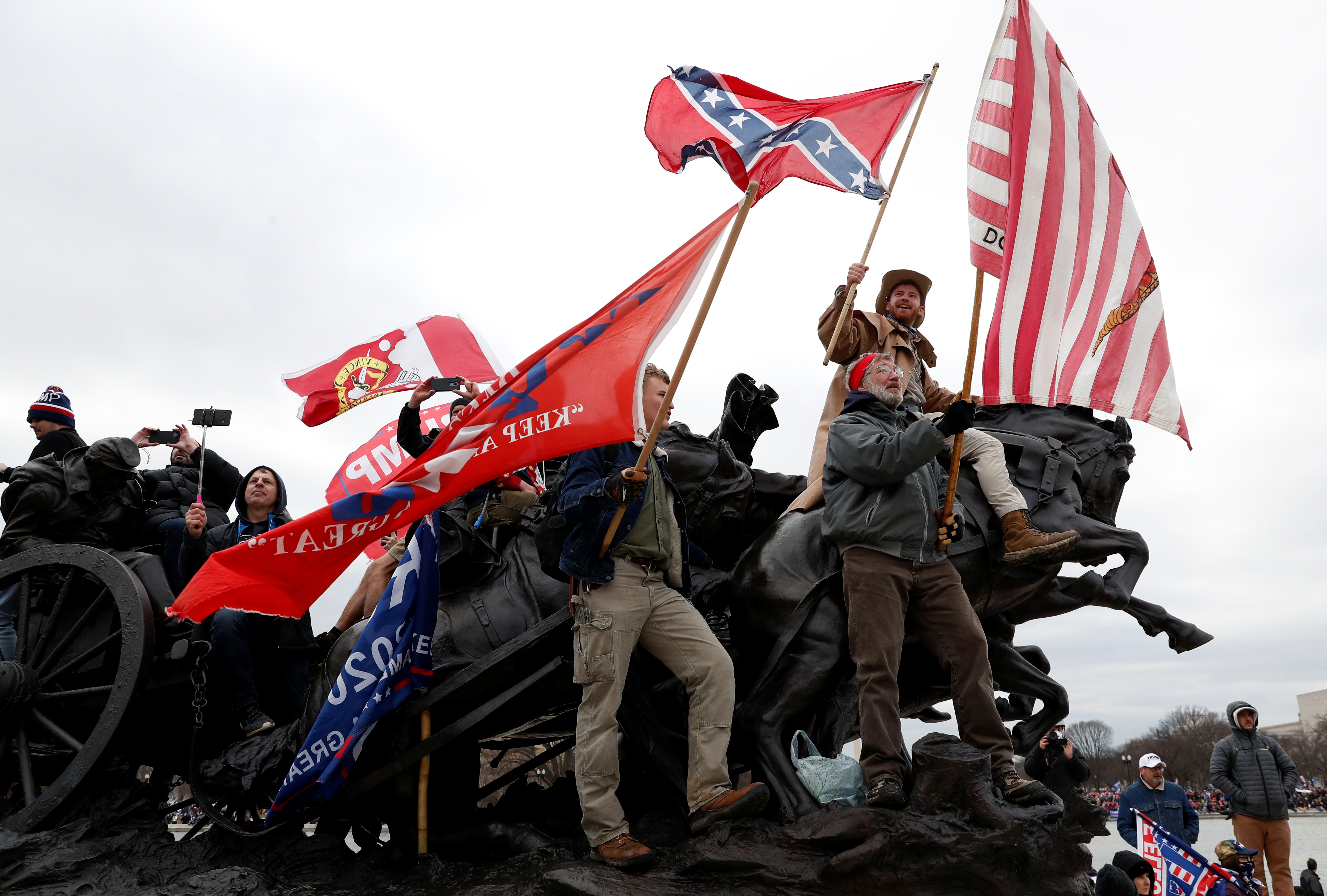 Pro-Trump protesters wave banners during clashes with Capitol police at a rally to contest the certification of the 2020 U.S. presidential election results by the U.S. Congress, at the U.S. Capitol Building in Washington, U.S, January 6, 2021. REUTERS/Shannon Stapleton
