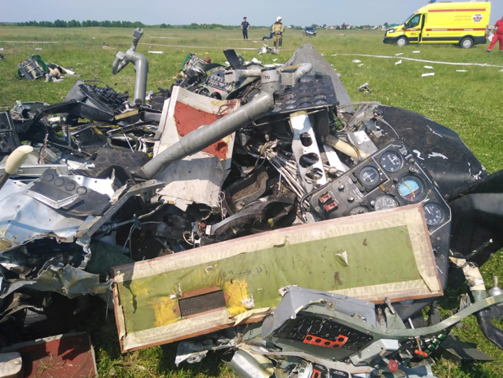 A view shows the wreckage of an L-410 plane that crashed near the Tanay aerodrome, which provides parachuting services, in Kemerovo Region, Russia June 19, 2021. Investigative Committee of Russia/Handout via REUTERS
