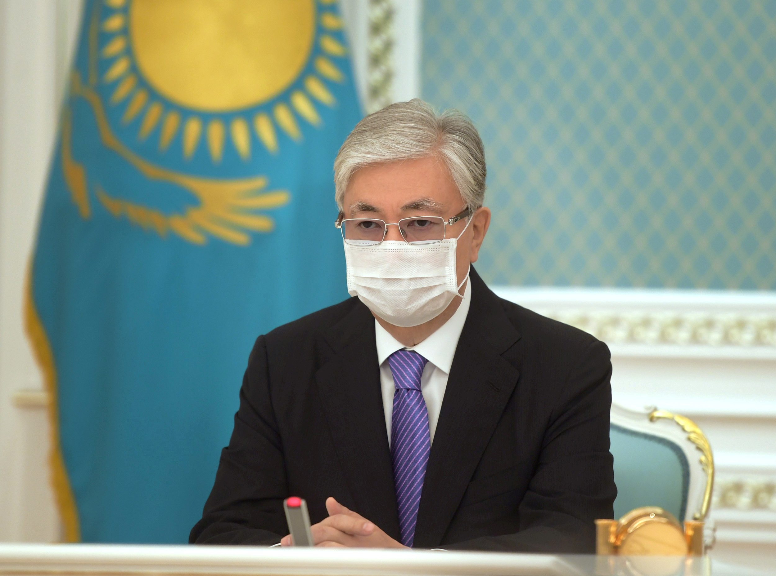 Kazakh President Kassym-Jomart Tokayev wearing a protective face mask participates online in the unveiling ceremony of a monument to Nursultan Nazarbayev, the first president of Kazakhstan, in Nur-Sultan, Kazakhstan July 3, 2020. Kazakh Presidential Press Service/Handout via REUTERS