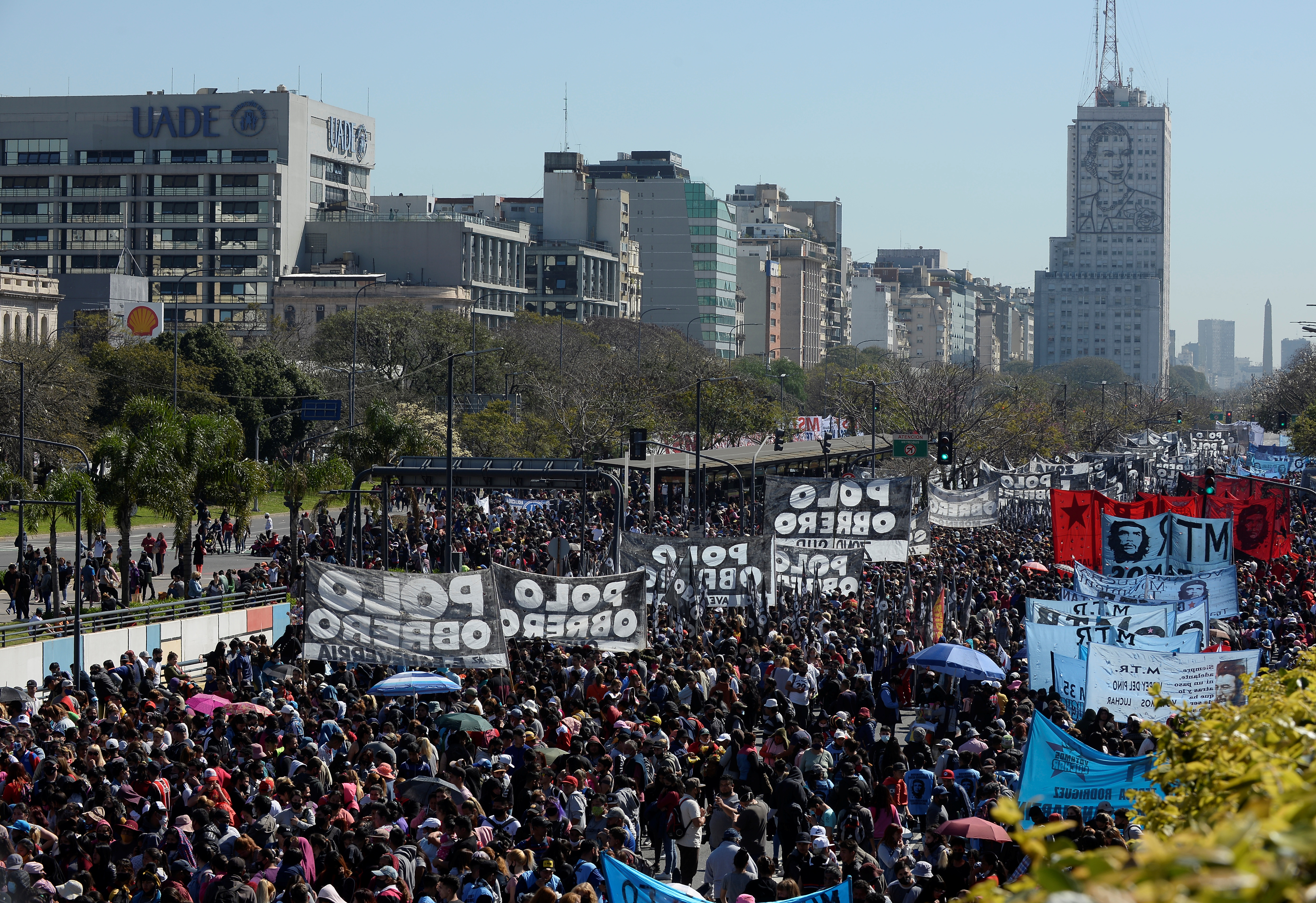 Demonstrators march to protest against unemployment, food insecurity and lack of resources near an image of Argentina's former first lady Eva Peron, in Buenos Aires, Argentina September 16, 2021.  REUTERS/Mariana Nedelcu