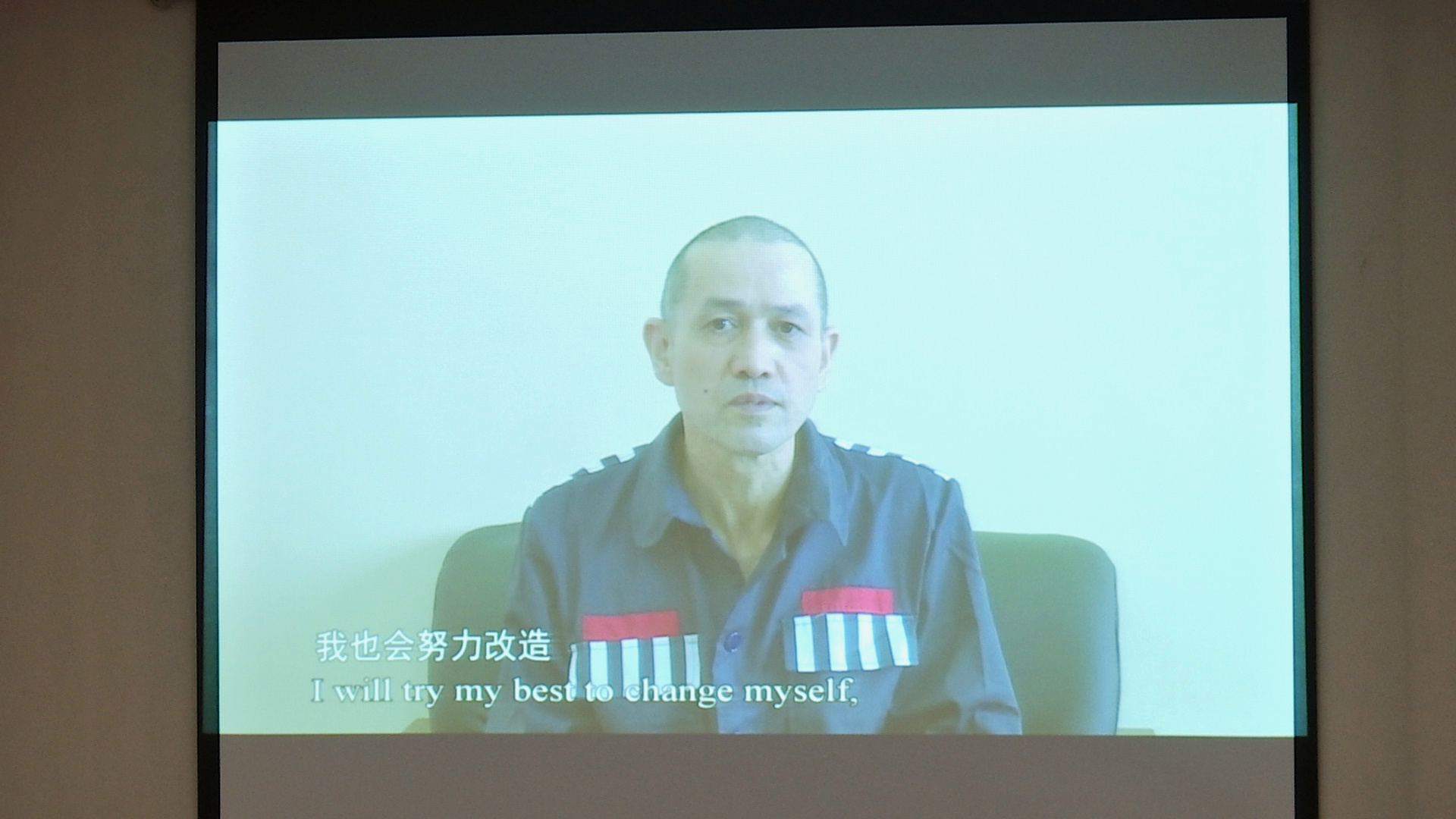 Erkin Tursun, a former TV producer whom officials said is serving a 20-year sentence in Xinjiang, is seen speaking on a video shown at a news conference on Xinjiang-related issues, in Beijing, China April 9, 2021. Reuters TV/via REUTERS