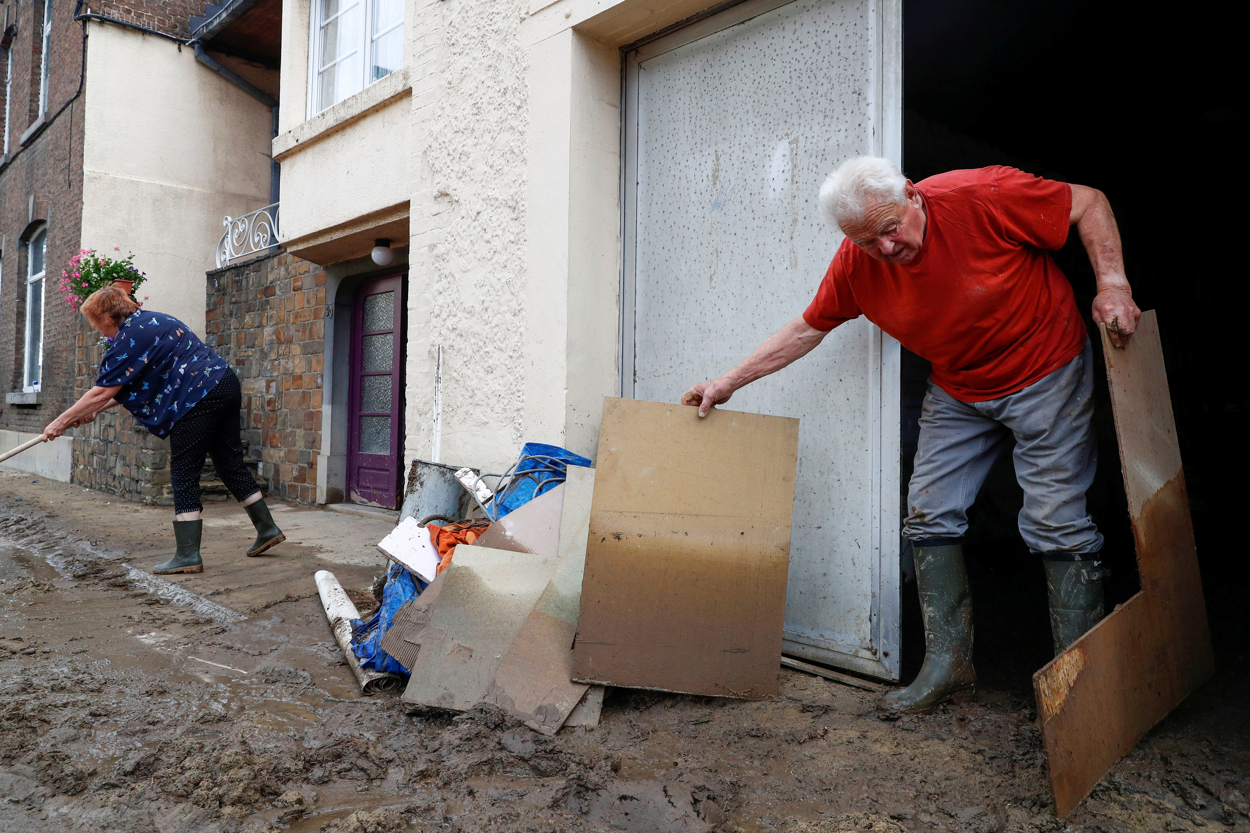 People work in an area affected by heavy rainfall in Dinant, Belgium July 25, 2021. REUTERS/Johanna Geron