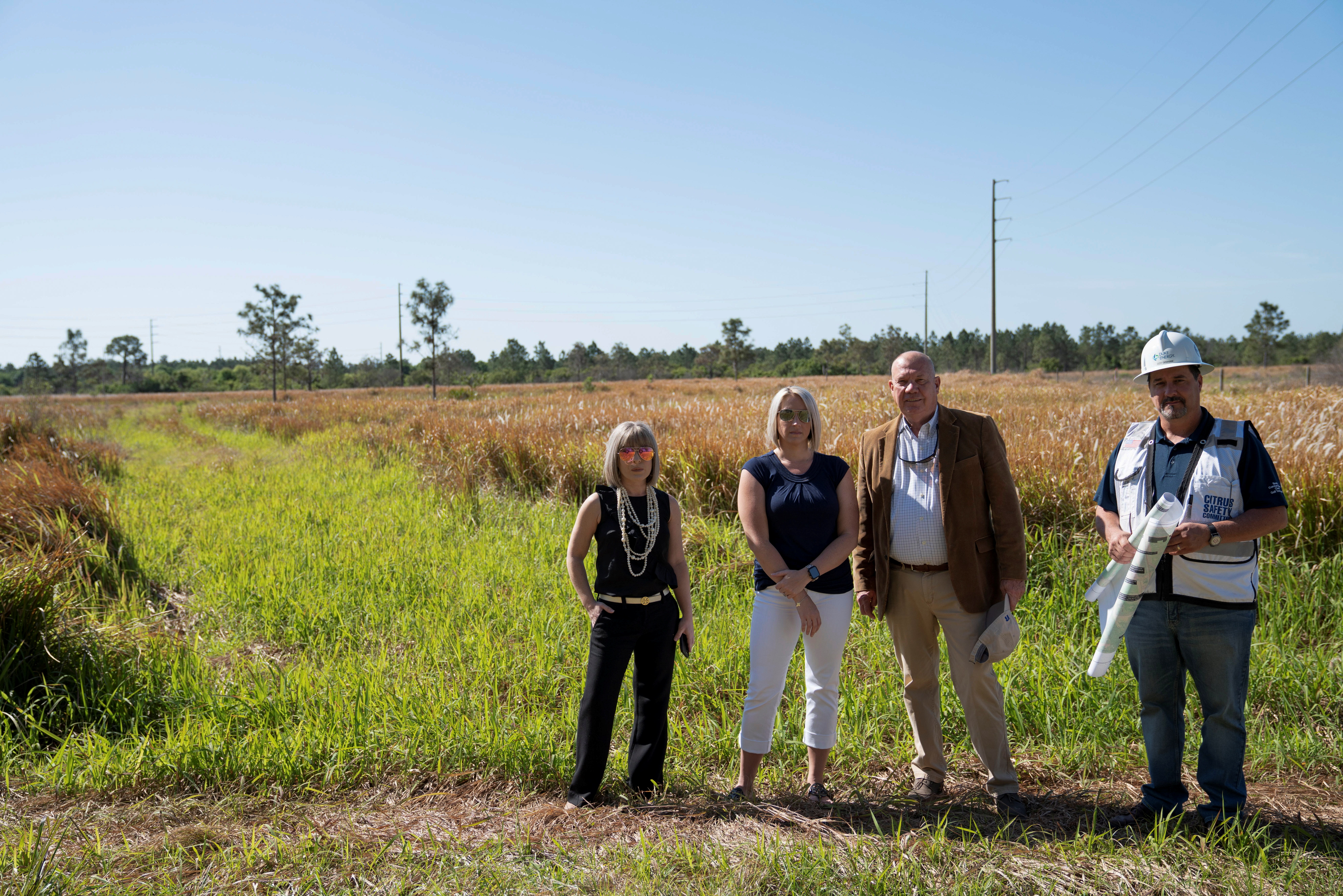 Duke Project Manager Coy Graham, Hardee County Economic Development Director Bill Lambert and team members Sarah Pelham and Kristi Schierling pose for a photo at the Hardee County Solar Development site in Fort Green, Florida, U.S., March 24, 2021.  REUTERS/Dane Rhys