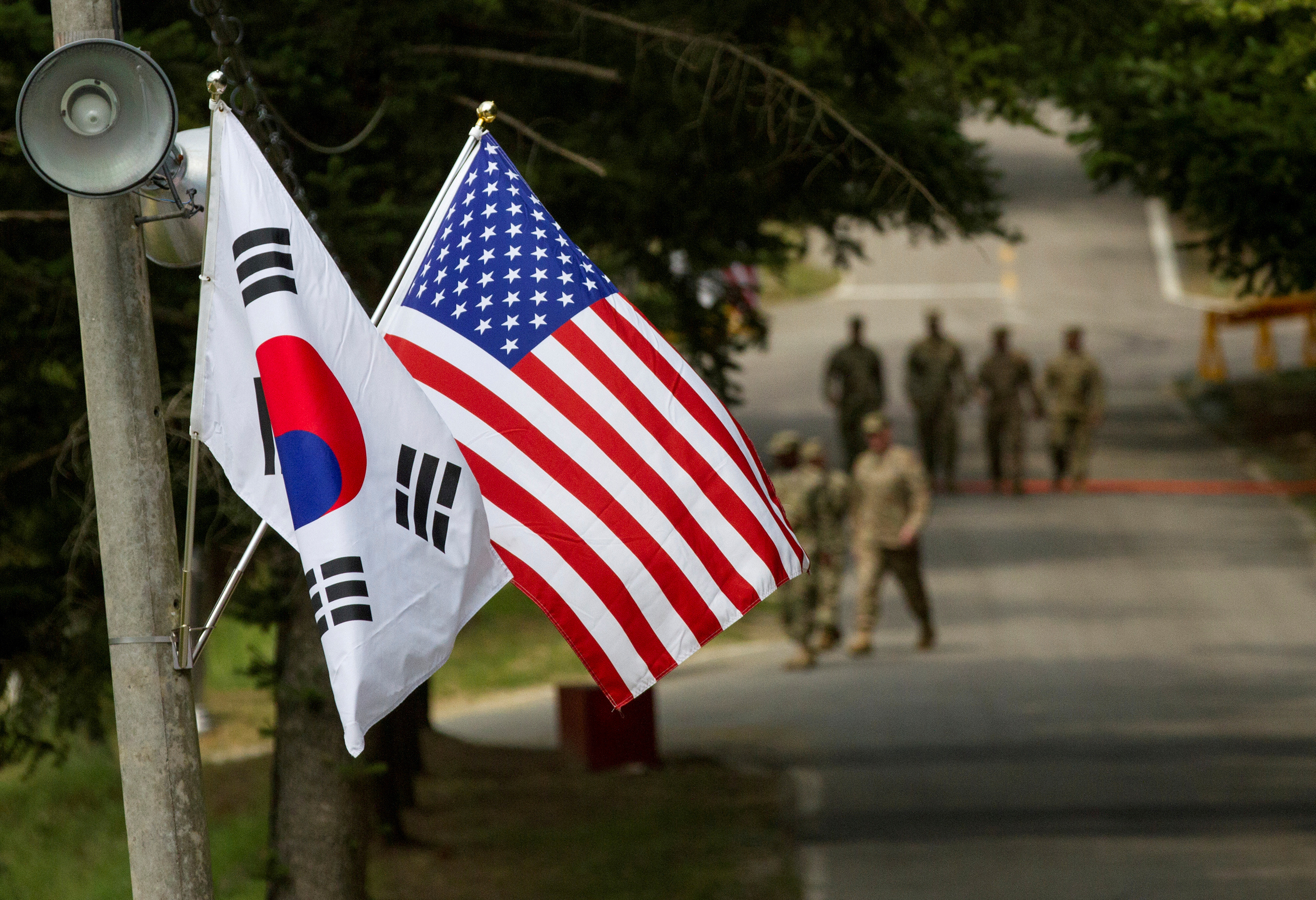 The South Korean and American flags fly next to each other at Yongin, South Korea, August 23, 2016.  Courtesy Ken Scar/U.S. Army/Handout via REUTERS