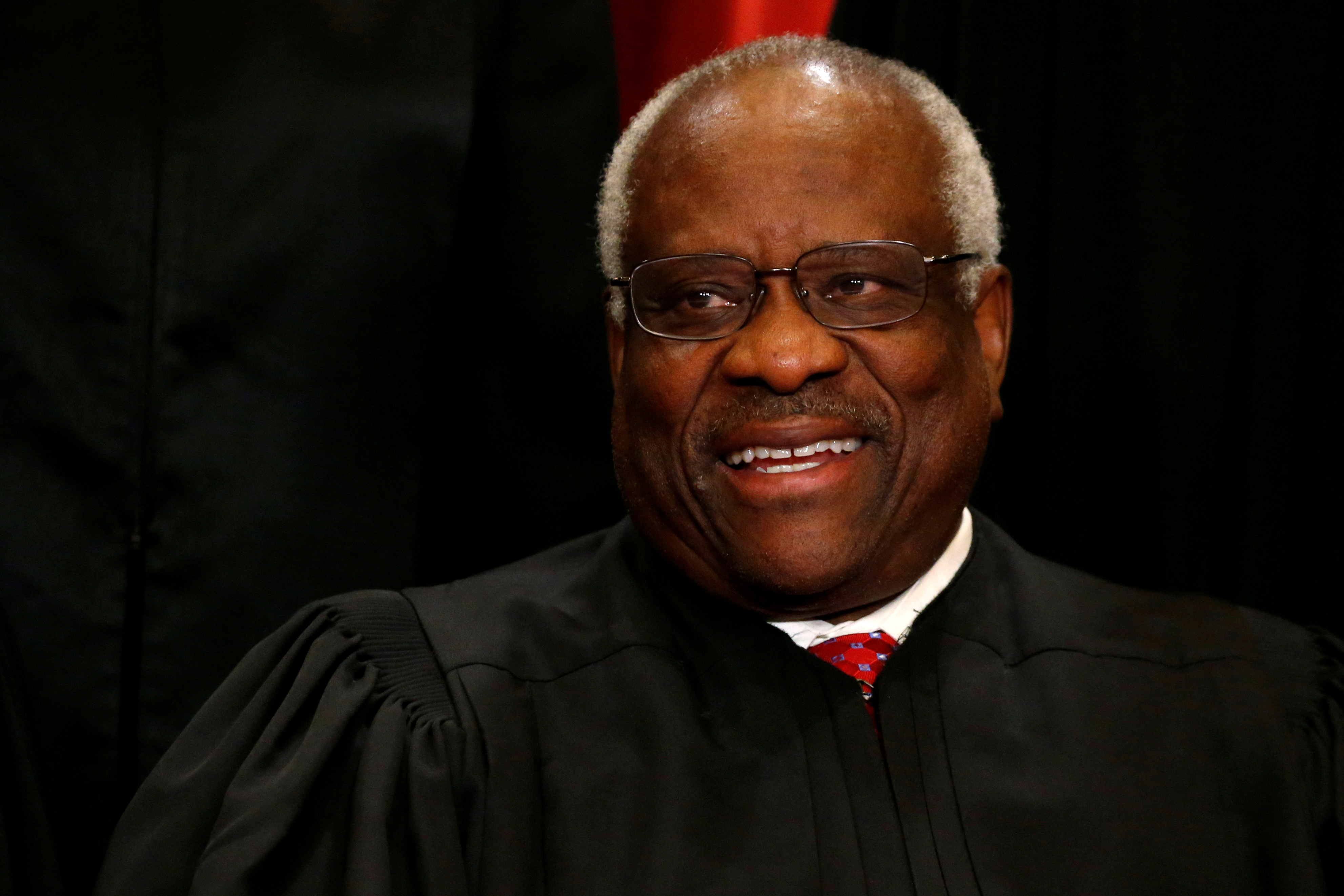 U.S. Supreme Court Justice Clarence Thomas participates in taking a new