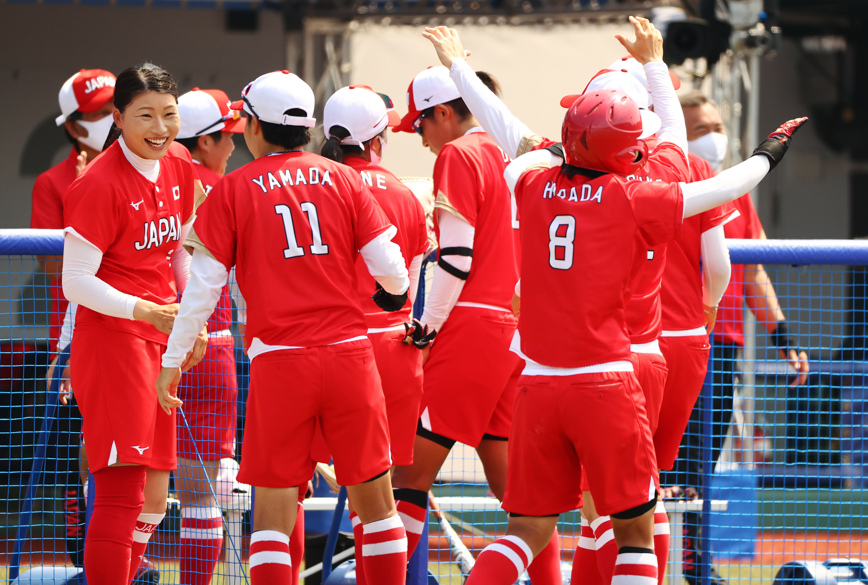 Tokyo 2020 Olympics - Softball - Women - Opening Round - Australia v Japan - Fukushima Azuma Baseball Stadium - Fukushima, Japan - July 21, 2021. Japan celebrates a home run. REUTERS/Jorge Silva