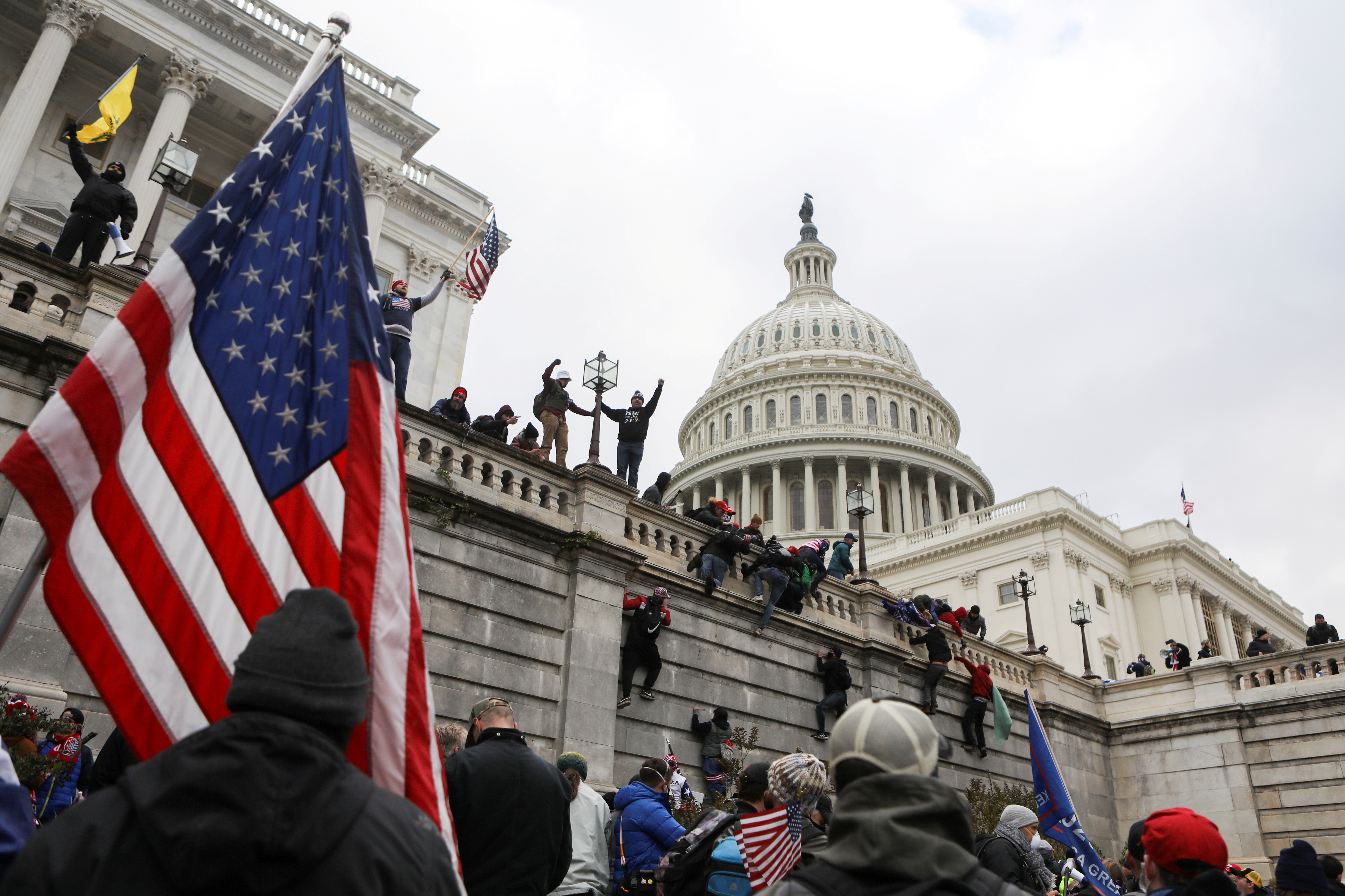Supporters of U.S. President Donald Trump climb on walls at the U.S. Capitol during a protest against the certification of the 2020 U.S. presidential election results by the U.S. Congress, in Washington, U.S., January 6, 2021. REUTERS/Jim Urquhart/File Photo