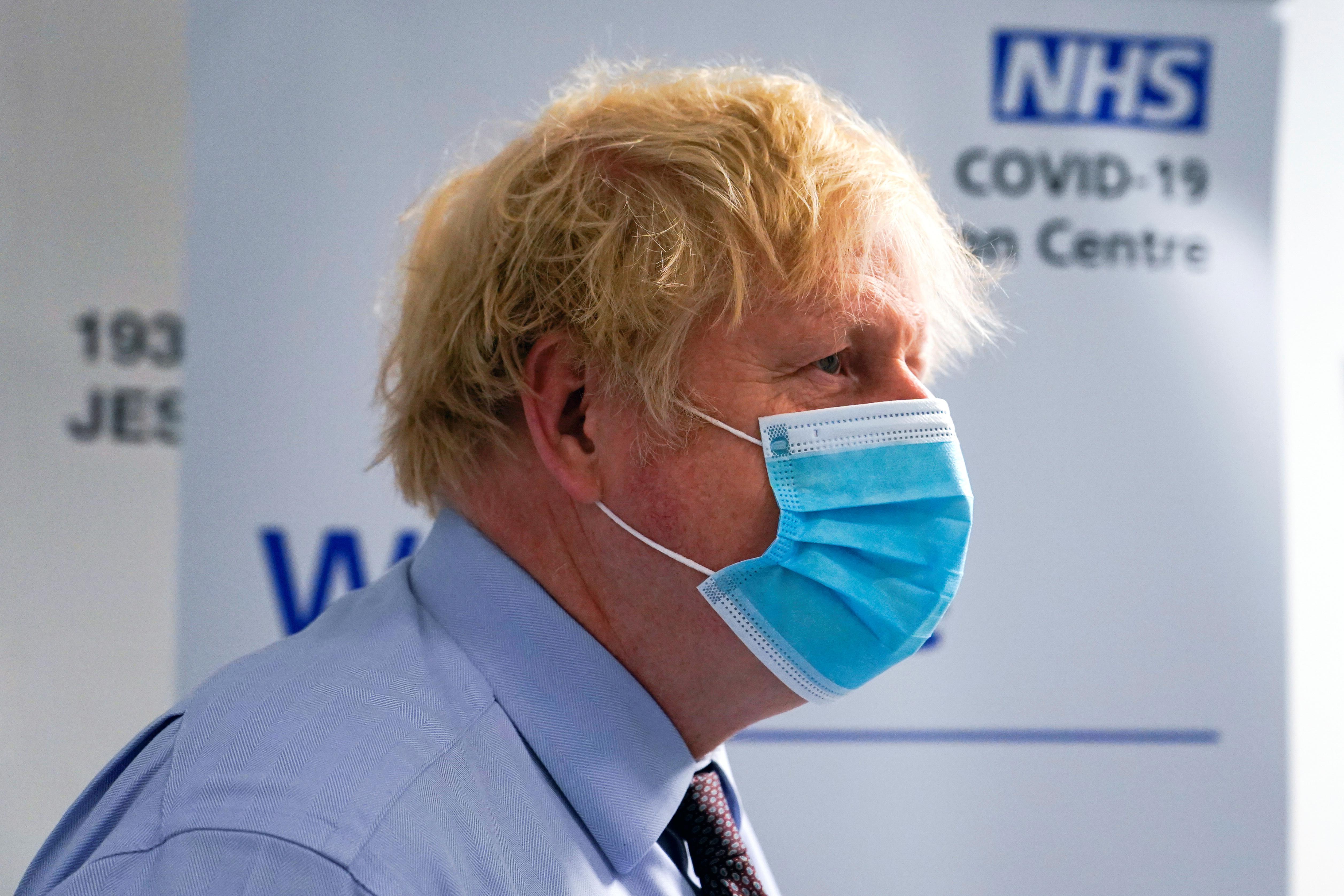 Britain's Prime Minister Boris Johnson visits a vaccination centre at the StoneX Stadium, home of the rugby club Saracens, amid coronavirus disease (COVID-19) pandemic, in North London, Britain June 21, 2021. Alberto Pezzali/Pool via REUTERS