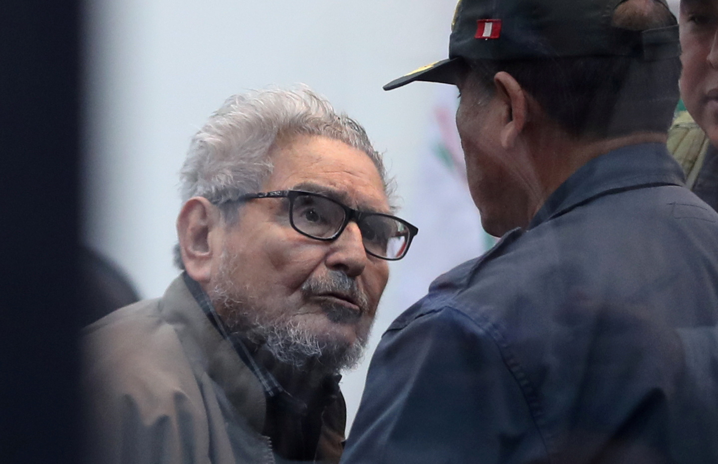 Shining Path founder Abimael Guzman attends a trial during sentence of a 1992 Shining Path car bomb case in Miraflores, at a high security naval prison in Callao, Peru September 11, 2018. REUTERS/Mariana Bazo